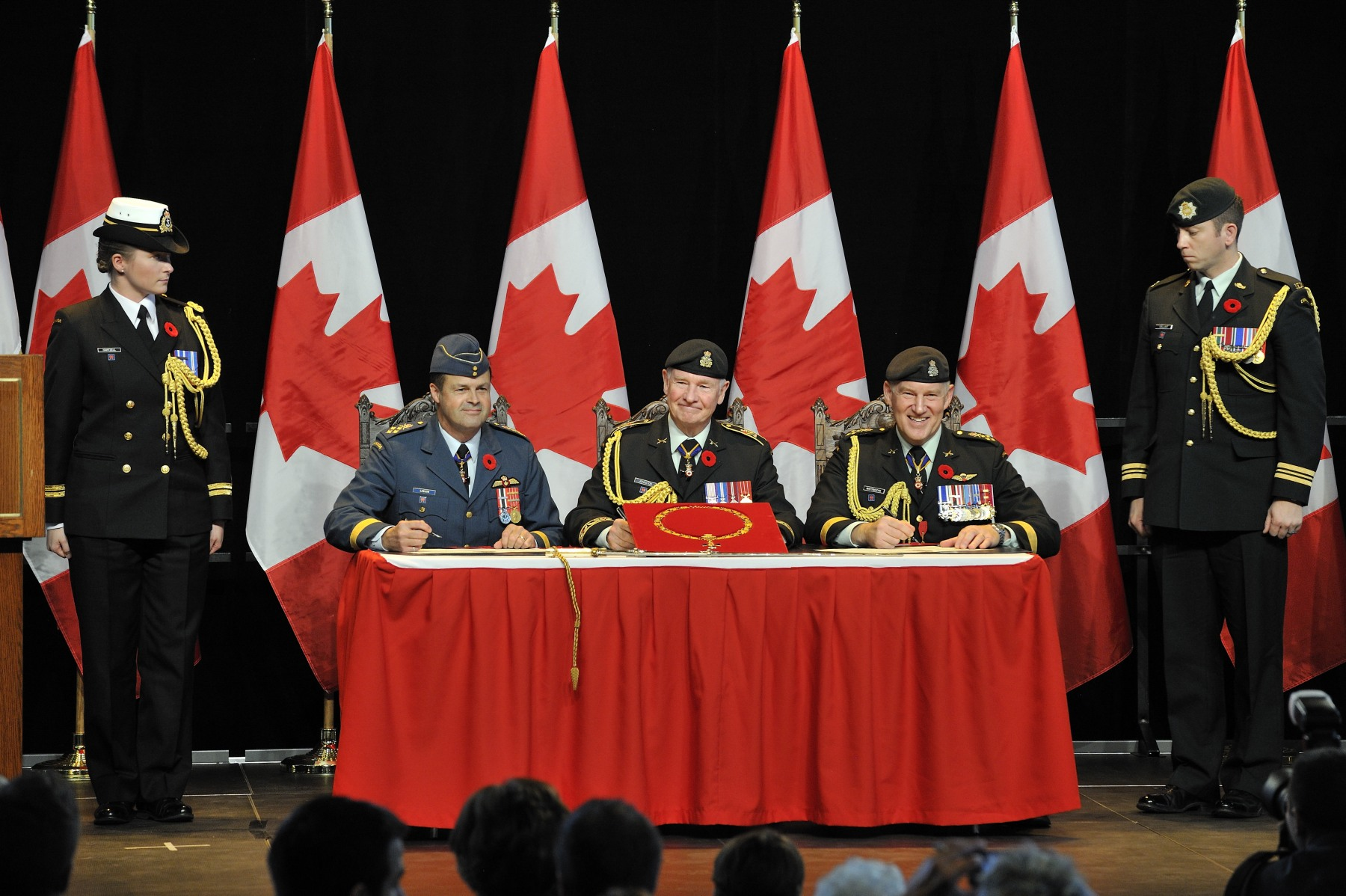 The Governor General, General Lawson and General Natynczyk signed the Change of Appointment Certificat.