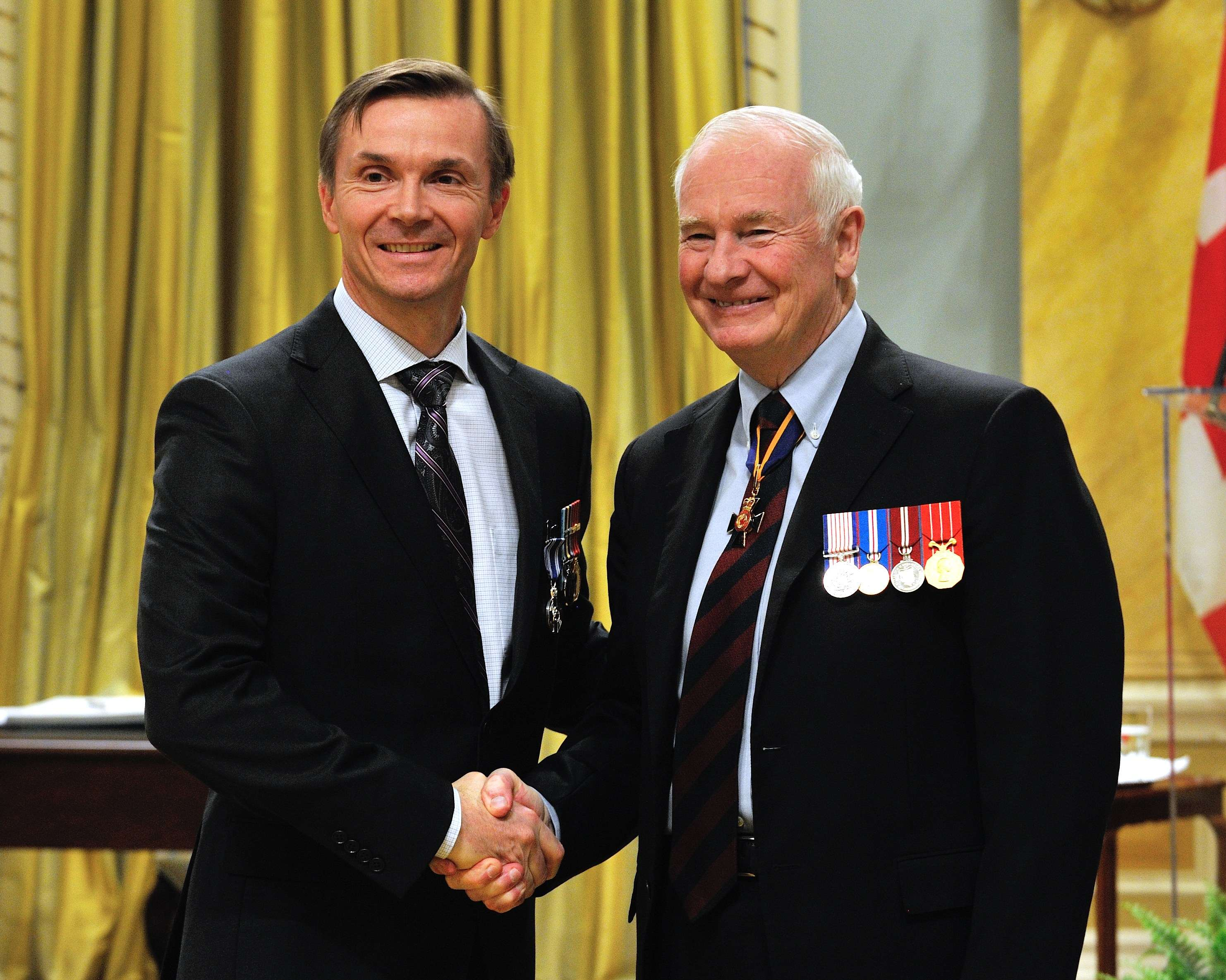 Commander Simon Rupert Hughes, M.S.M., C.D., received the Meritorious Service Medal (Military Division). Between August 2010 and January 2012, Commander Hughes contributed strategic benefit to the Royal Canadian Navy. He was instrumental in conceiving and developing innovative approaches, which made sure of the readiness of naval personnel for the introduction of the internationally successful REGULUS program and the adoption of the Single Fleet Scheme of Manoeuvre. Commander Hughes' leadership, strategic wisdom and groundbreaking work helped ensure the future success of the Navy, the Canadian Forces and Canada.