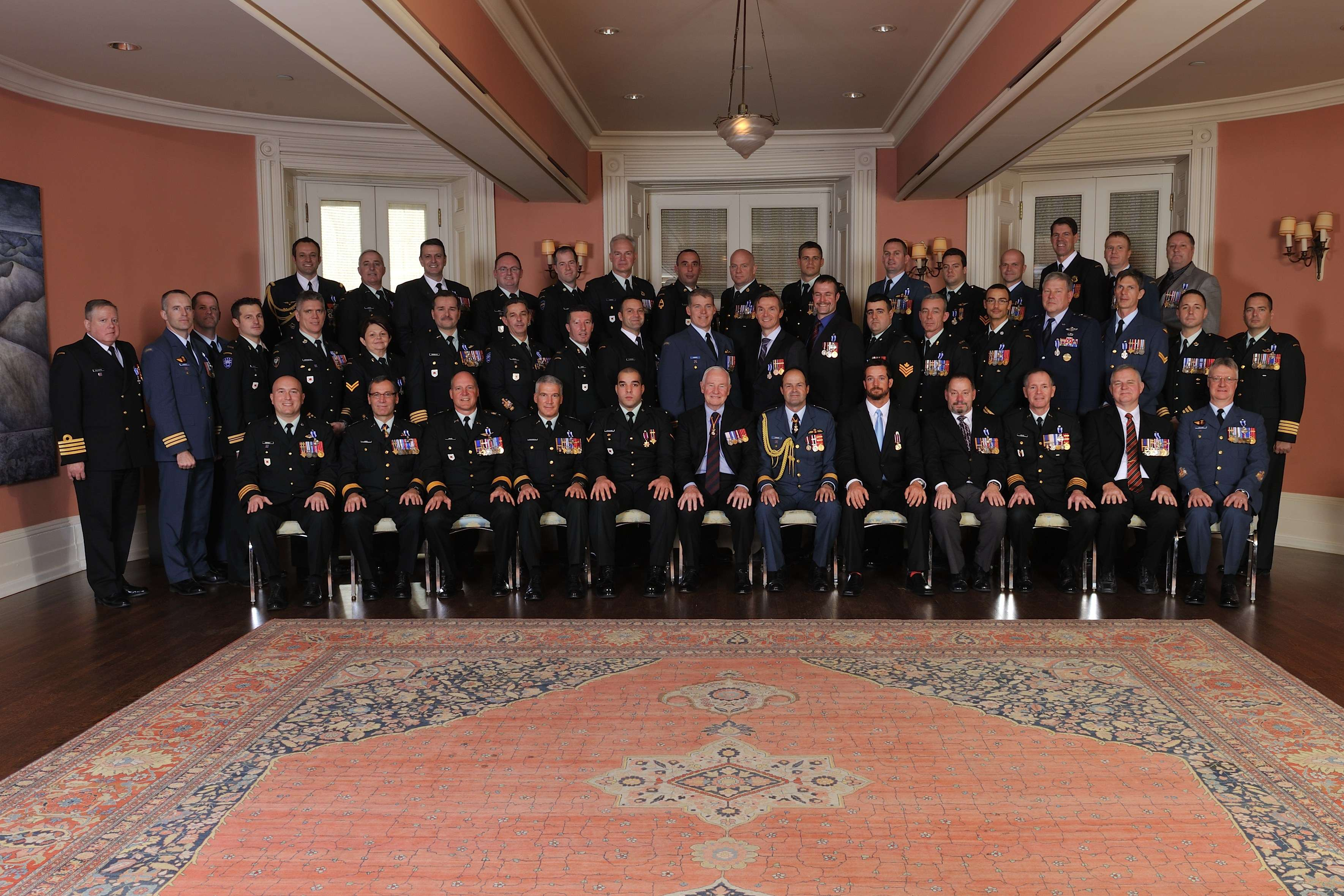 His Excellency the Right Honourable David Johnston, Governor General of Canada, and General Thomas Lawson, Chief of the Defence Staff, are pictured with the 45 recipients who were presented with military decorations.