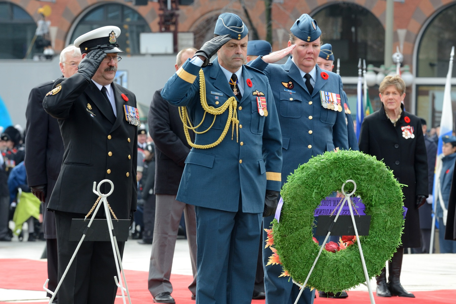 The newly appointed Chief of the Defense Staff General Tom Lawson also laid a wreath.