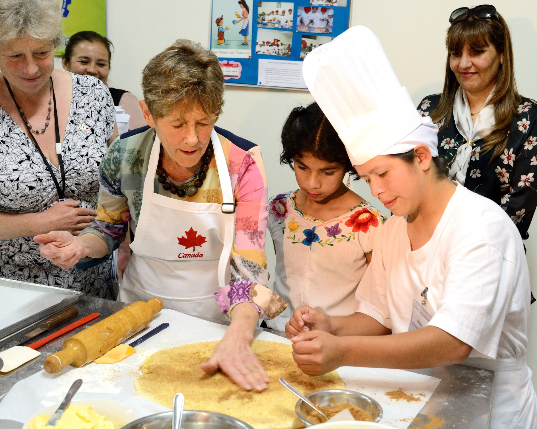 Her Excellency then visited the kitchen were she showed children how to make cinnamon buns.