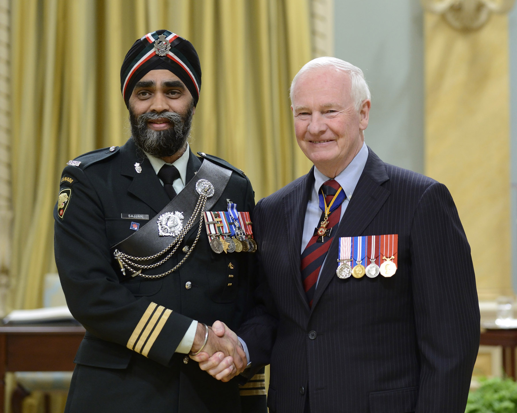 Major Harjit Sajjan, M.S.M., C.D. (Vancouver, British Columbia) received the Meritorious Service Medal (Military Division). Major Sajjan deployed to Afghanistan as a special advisor from February to November 2009, and from November 2010 to March 2011. His approach, based on his knowledge of local culture and tribal dynamics, helped senior management to engage with influential Afghan tribal leaders, and led to the identification of insurgent command and control connection points. Taking every opportunity to deploy forward to refine his leads, Major Sajjan provided critical situational awareness and reduced the Taliban's influence in Kandahar province through his sound analysis.