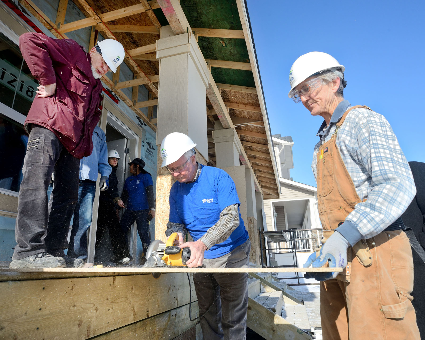During the visit to Calgary the Governor General teamed up with Habitat for Humanity Southern Alberta to help construct a duplex in Evanston.