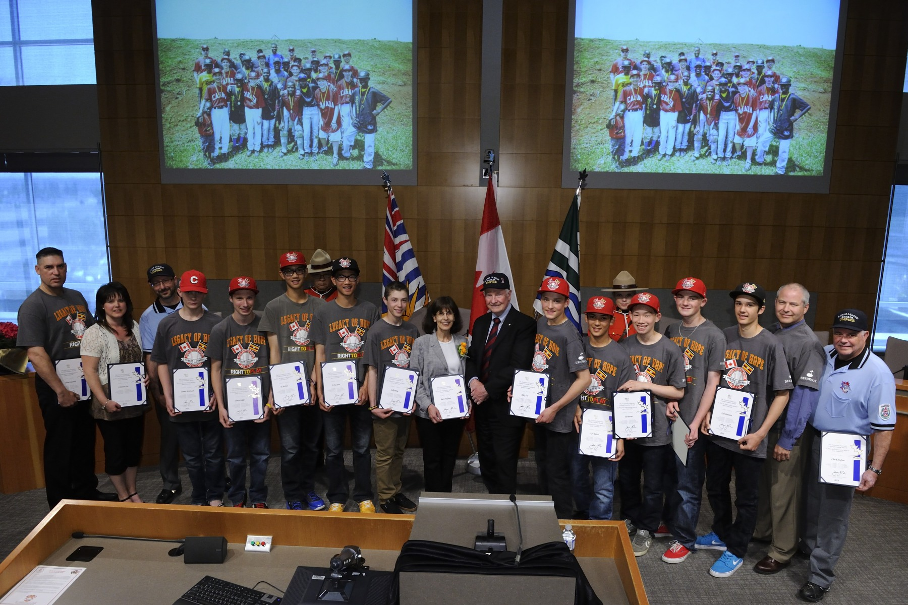 His Excellency presented the Governor General's Caring Canadian Award to the Langley Little League team for their community service during the 2012 Pearl of Africa Series.