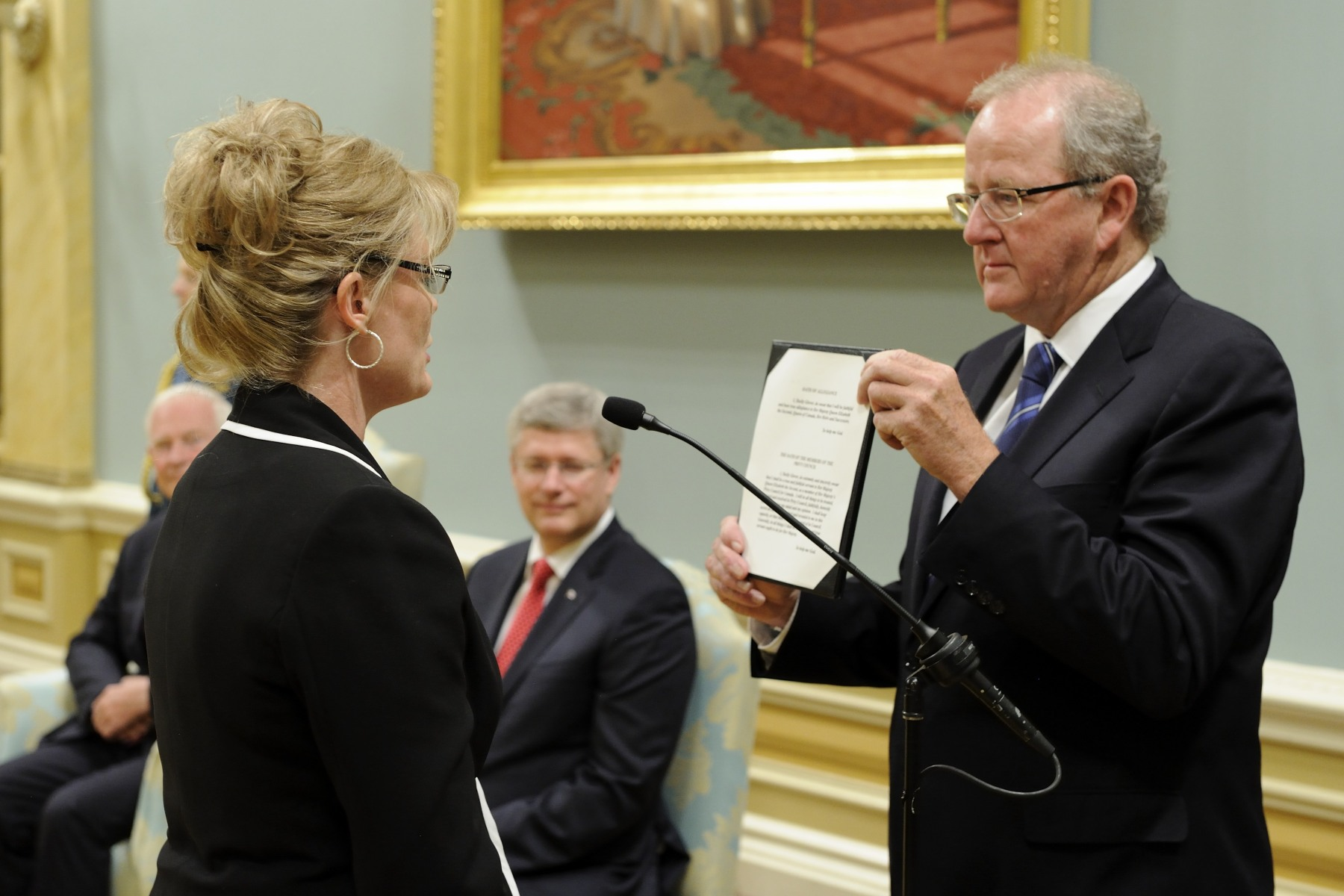 During a swearing-in ceremony at Rideau Hall on July 15, 2013, members of the 28th federal Ministry were presented. Each candidate approached Mr. Wayne Wouters, Clerk of the Privy Council and Secretary to the Cabinet, and took their oath.