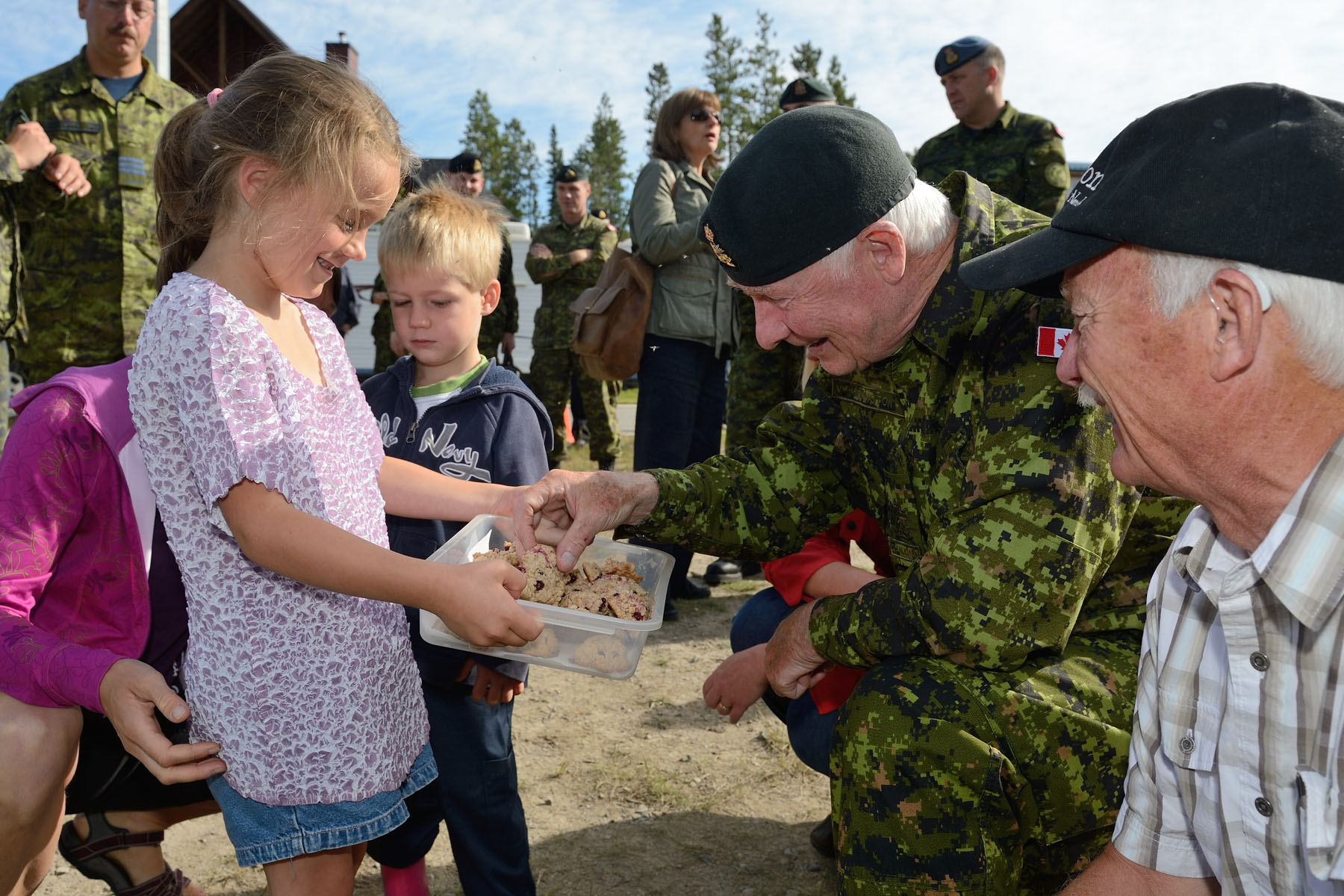 The Governor General enjoyed some homemade cookies during his tour of military operations.