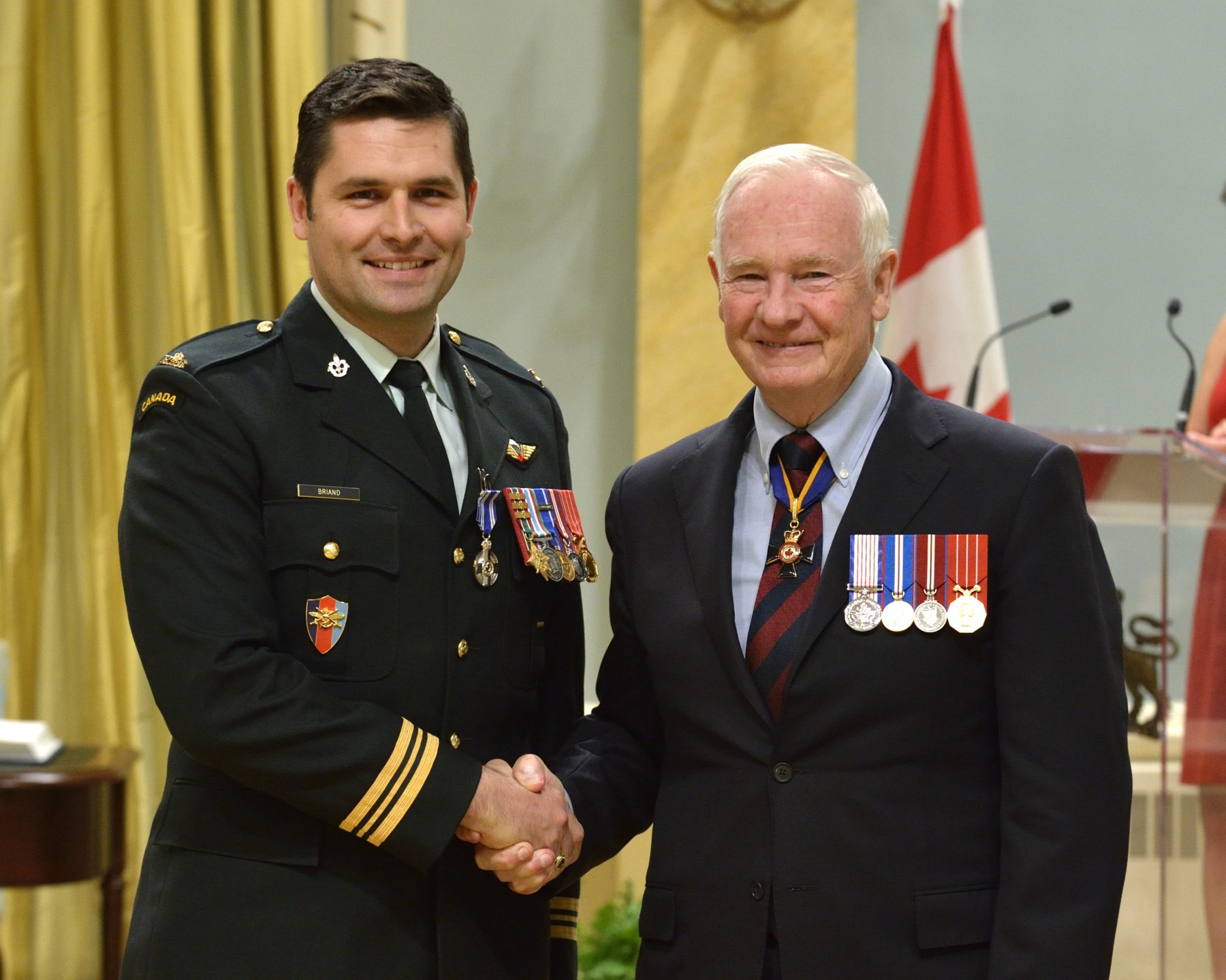 Major Joseph Éric Stéphane Briand, M.S.M., C.D. (LaSalle, Quebec) received the Meritorious Service Medal (Military Division). Major Briand commanded a team of mentors deployed to Afghanistan from November 2010 to June 2011, where he distinguished himself by his exceptional strategic acumen. With extraordinary initiative, he professionalized the efforts of the Afghan National Army on several occasions, both while stationed in garrison and in the field. Major Briand's keen planning sense, resilience and composure contributed greatly to the operational success of the coalition forces.