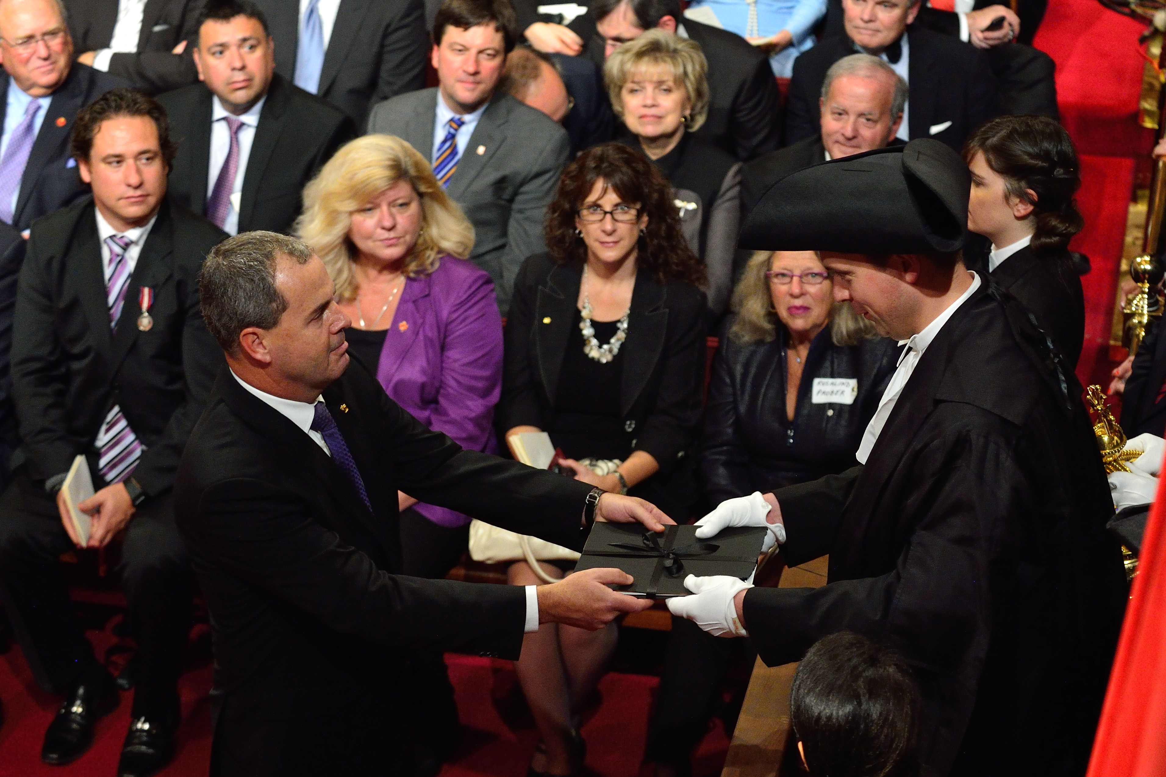 During the ceremony, Secretary to the Governor General Mr. Stephen Wallace (left) presented a copy of the Speech to the Speaker of the House of Commons The Honourable Andrew Scheer (right).