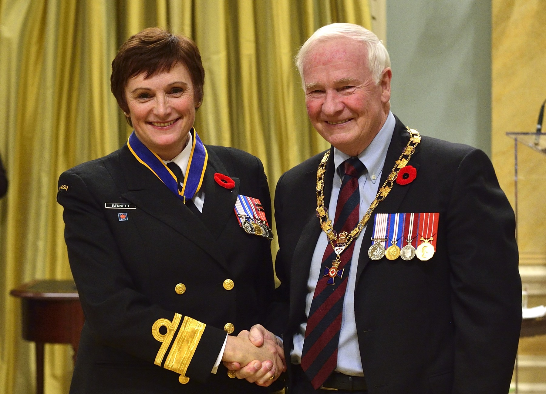 His Excellency presented the Order of Military Merit at the Commander level (C.M.M.) to Rear-Admiral Jennifer Bennett, C.M.M., C.D., Director General Reserves and Cadets, Ottawa, Ont. This is a promotion within the Order.