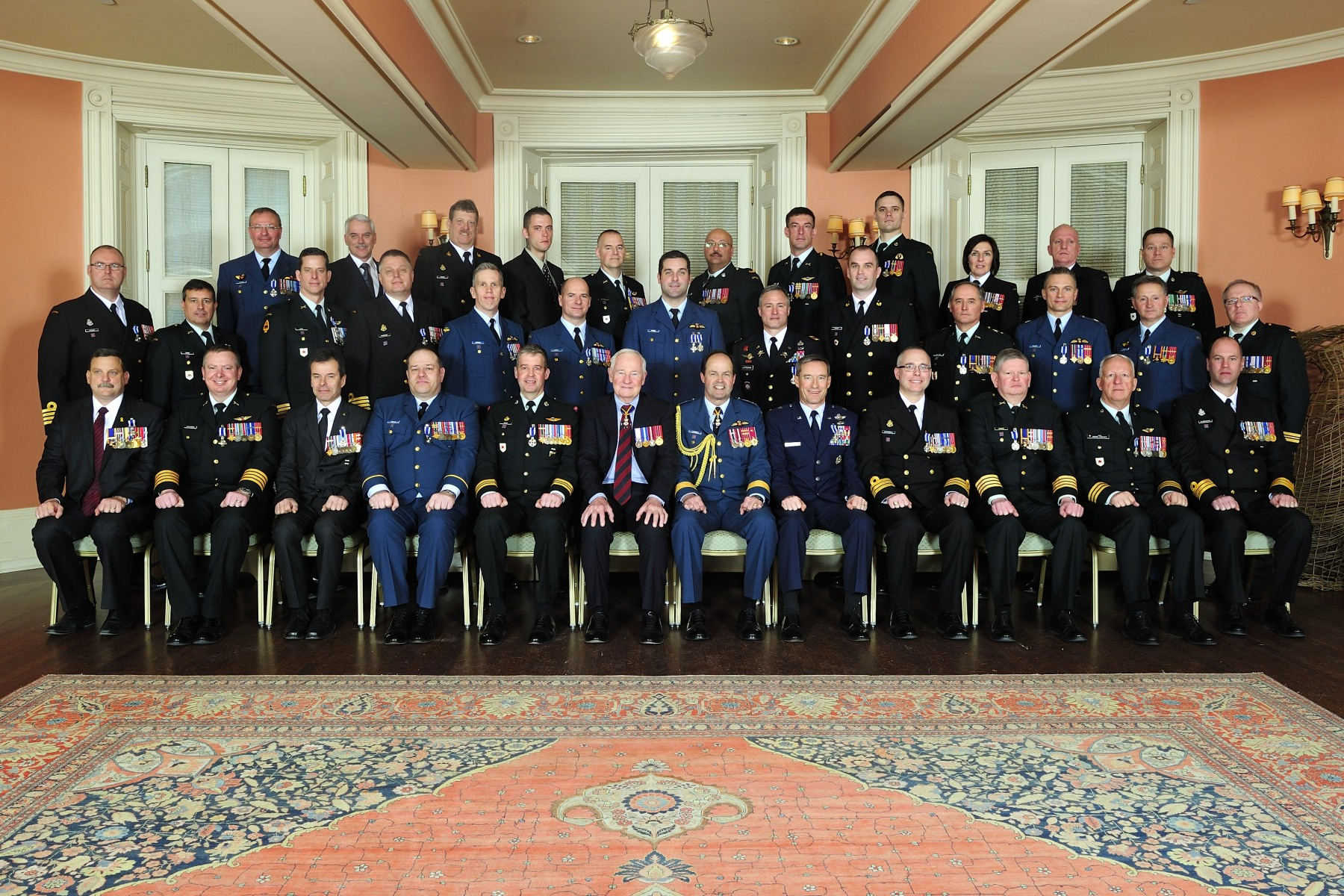 The Governor General and the Chief of the Defence Staff are pictured with the 34 recipients who were presented with Meritorious Service Decorations (Military Division) on February 18, 2014.
