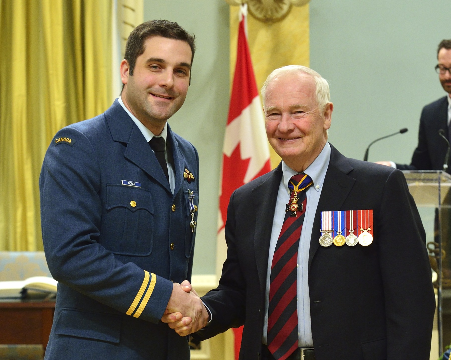 Captain Aaron Noble, M.S.C. (Burnaby, British Columbia) also received the Meritorious Service Cross. On October 27, 2011, aircraft commander Captain Noble, onboard Rescue 915, was tasked with rescuing two hunters stranded in Foxe Basin, near Igloolik, Nunavut. The mission would require over 2 000 kilometres of travel, far exceeding the maximum aircrew day. Despite aircraft limitations, adverse weather conditions and compounding operational complexities, Captain Noble expertly planned and executed his mission, saving the lives of the two hunters, and recovering the three search and rescue technicians who had parachuted in to assist them.