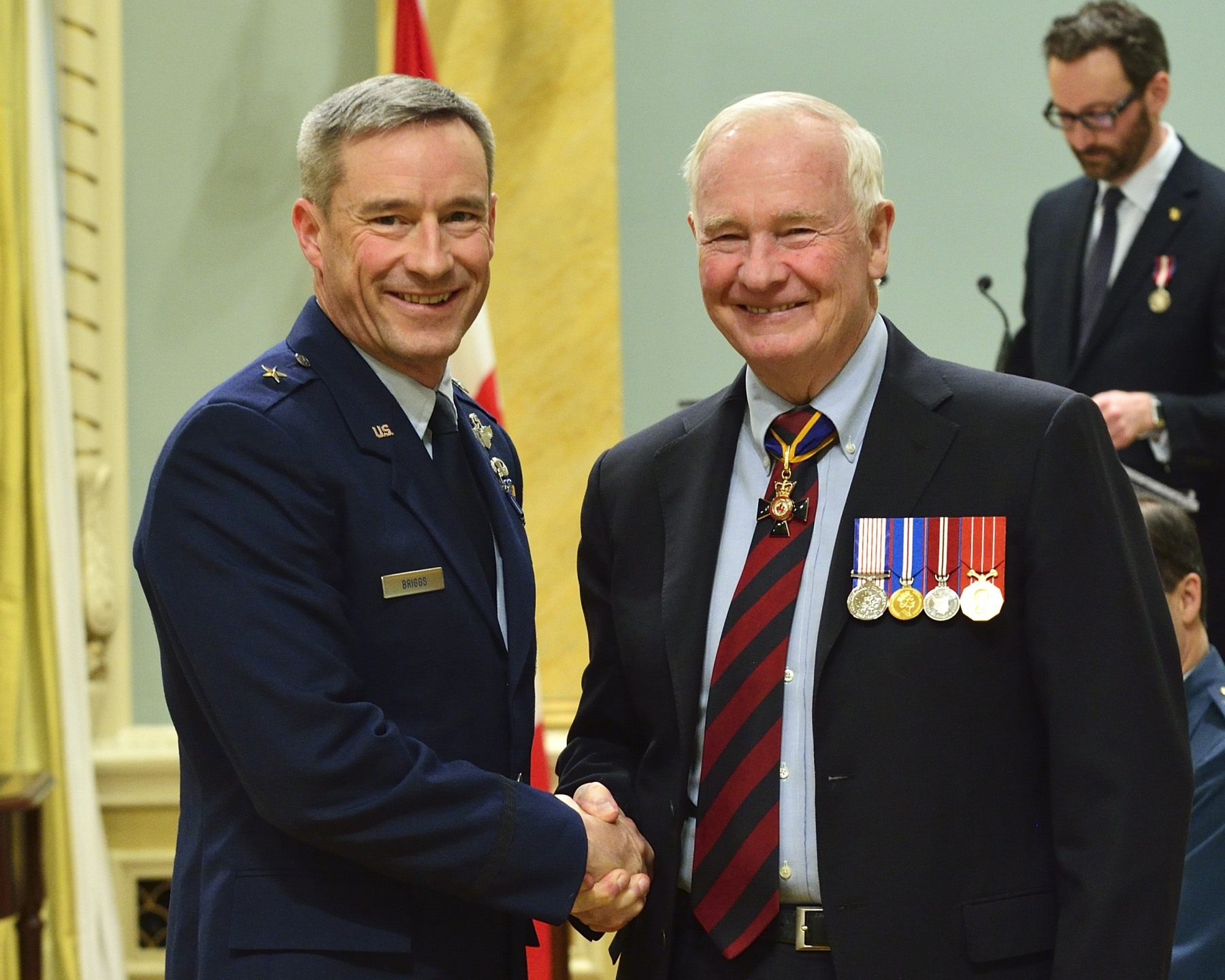 "Brigadier-General Jack L. Briggs II, M.S.M. of the United States Air Force (Spokane, Washington, U.S.A.) received one of the 32 Meritorious Service Medals. Between July 2011 and October 2013, as deputy combined/joint forces air component commander at 1 Canadian Air Division/Canadian NORAD Region Headquarters, Brigadier-General Briggs was instrumental in the successful delivery of the ""NORAD defence of North America"" mission, and of the Canadian Armed Forces' domestic operations and international combat and support missions. Brigadier-General Briggs's performance has strengthened our relationship with our United States allies and has contributed to the ongoing pursuit of our North American security goals."