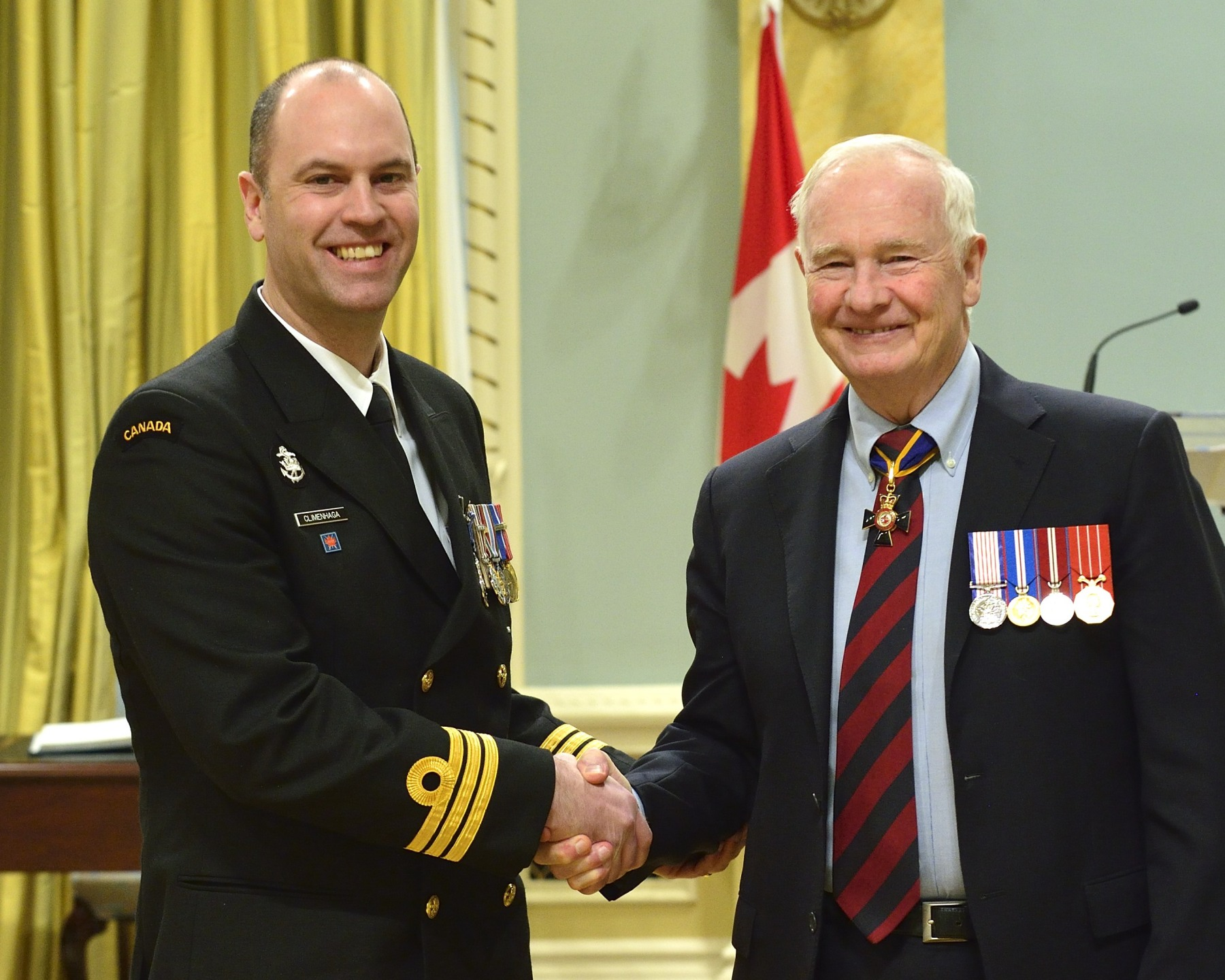 Commander Jeffrey Campbell Climenhaga, M.S.M., C.D. (Kindersley, Saskatchewan) received the Meritorious Service Medal. While deployed to Afghanistan from March to November 2012, Commander Climenhaga delivered an exceptional performance as the J7 within the Deputy Commander-Special Operations Forces organization, and as the senior Canadian at Camp Eggers. He planned, coordinated and executed equipment acquisitions, as well as oversaw the building of infrastructure that greatly enhanced the capabilities of the Afghan National Army, all while concurrently ensuring Canadian personnel were fully supported.