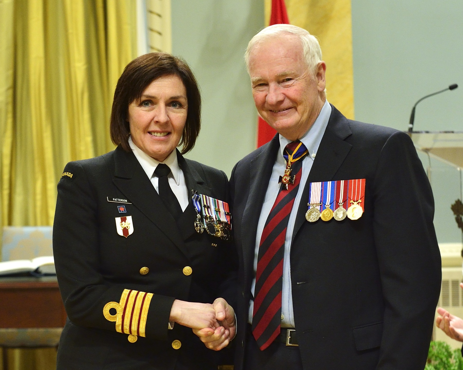Captain(N) Rebecca Louise Patterson, M.S.M., C.D. (Ottawa, Ontario) received the Meritorious Service Medal. From July 2011 to July 2012, Captain Patterson deployed to Afghanistan as the team leader of the Armed Forces Academy of Medical Sciences. Through her in-depth understanding of health systems, she significantly enhanced the level of medical training provided by this institution, and paved the way for its ongoing improvement. Captain Patterson's proactive leadership, professionalism and vast medical knowledge fostered excellence at this critical institution, and brought great credit to the Canadian Armed Forces.