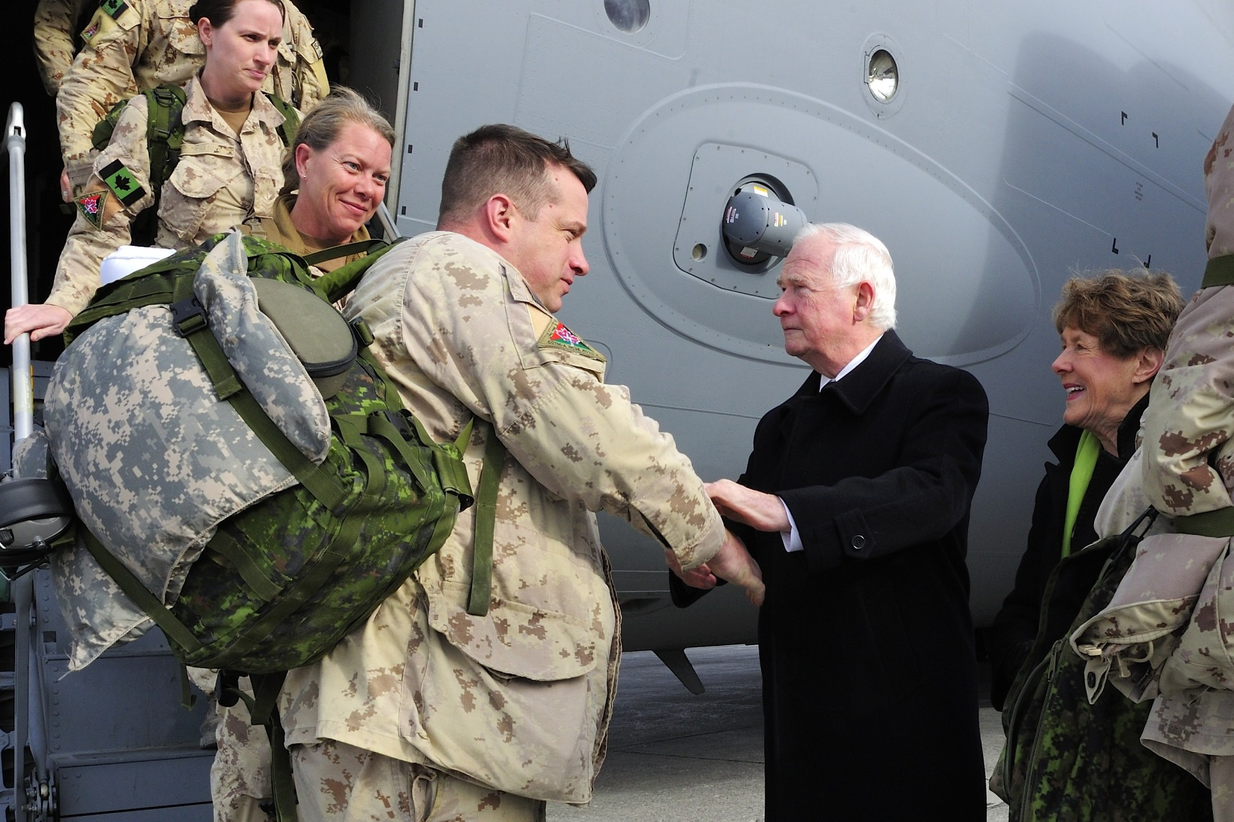 His Excellency, as commander-in-chief, greeted the returning troops.