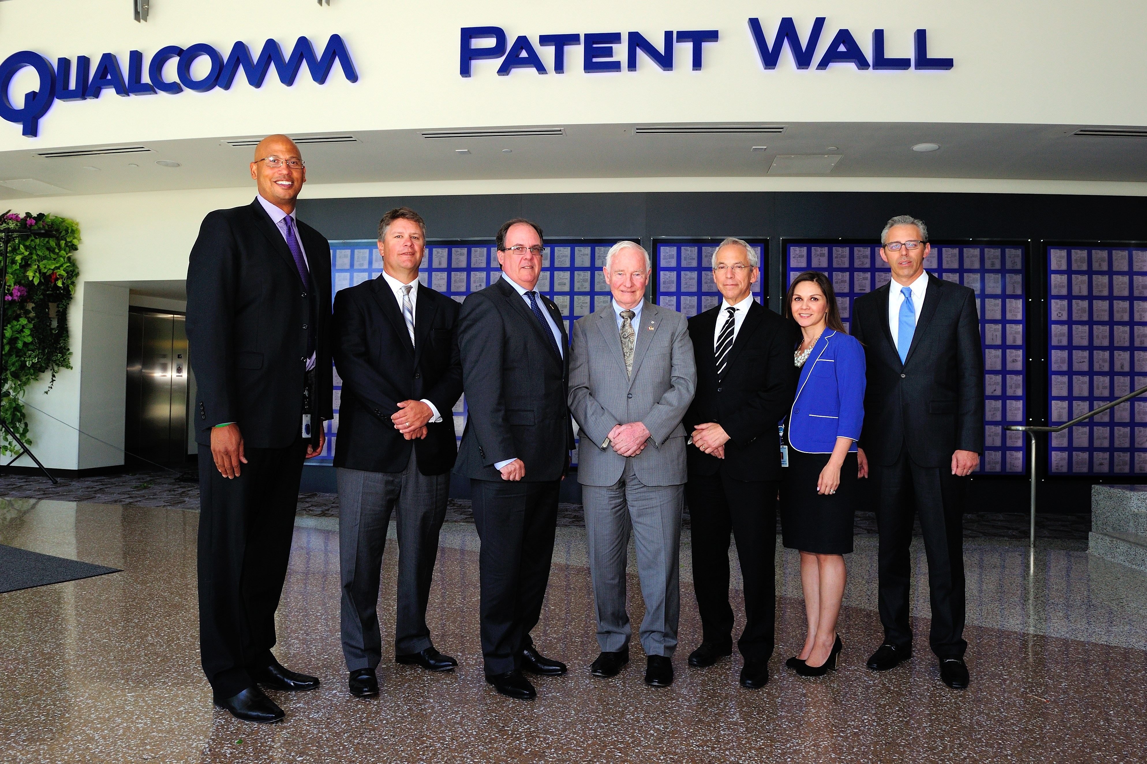 Official photo of the Governor General with executives from Qualcomm in front of their patent wall. Since its founding in 1985, Qualcomm has become one of the principal drivers of San Diego's high-technology economy, spurring numerous start-up companies and attracting other major players in the industry to San Diego. Qualcomm is the world's leading mobile chipset provider and employs 21 000 workers worldwide.