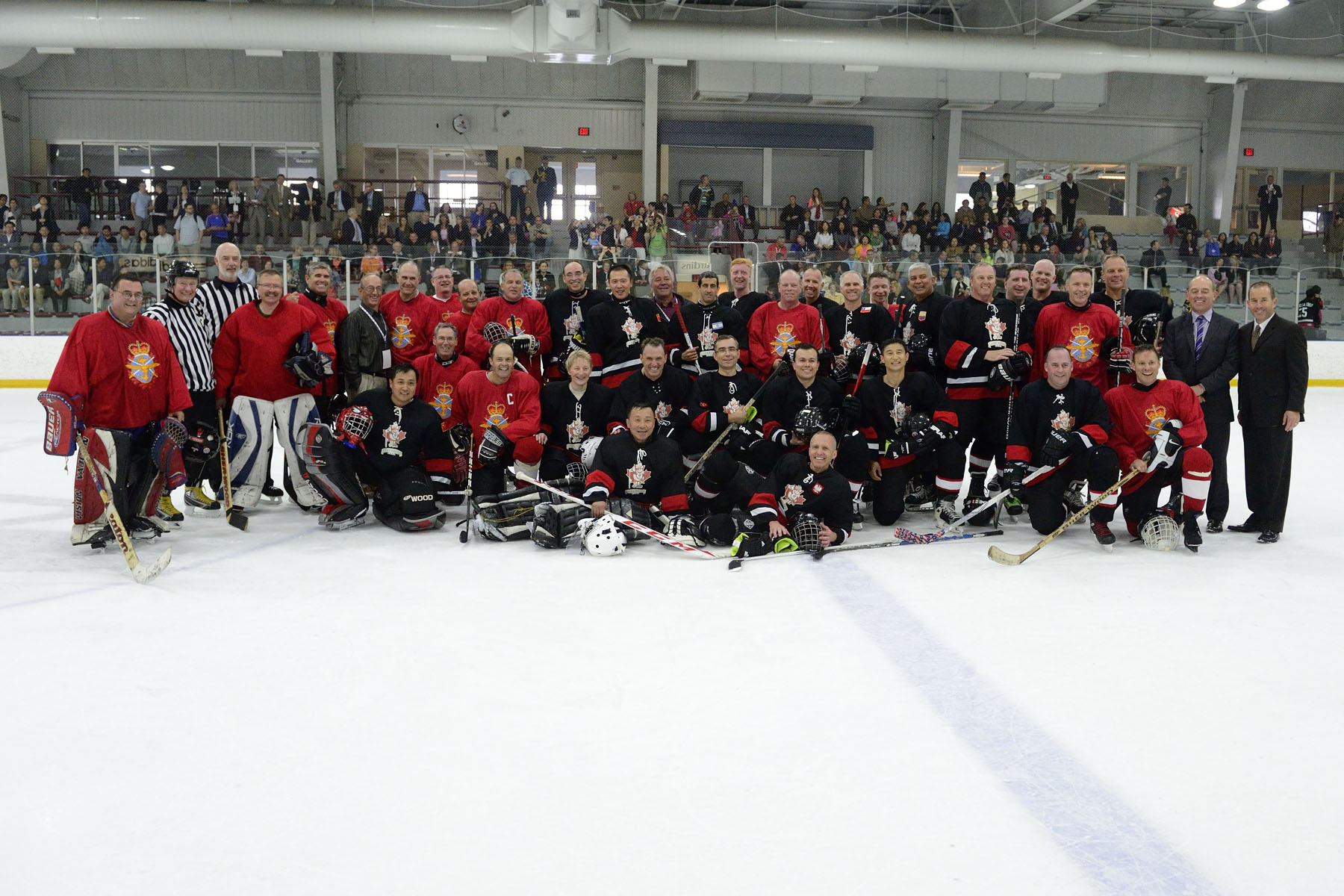 Group photo with His Excellency and players from the GOFO and the Lame Ducks teams.
