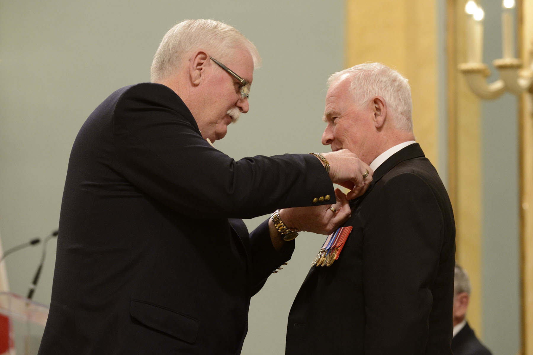 His Excellency received the symbolic first poppy of the campaign from Comrade Tom Eagles, Dominion President of The Royal Canadian Legion. Poppies will be available to the general public beginning Friday, October 31, 2014.