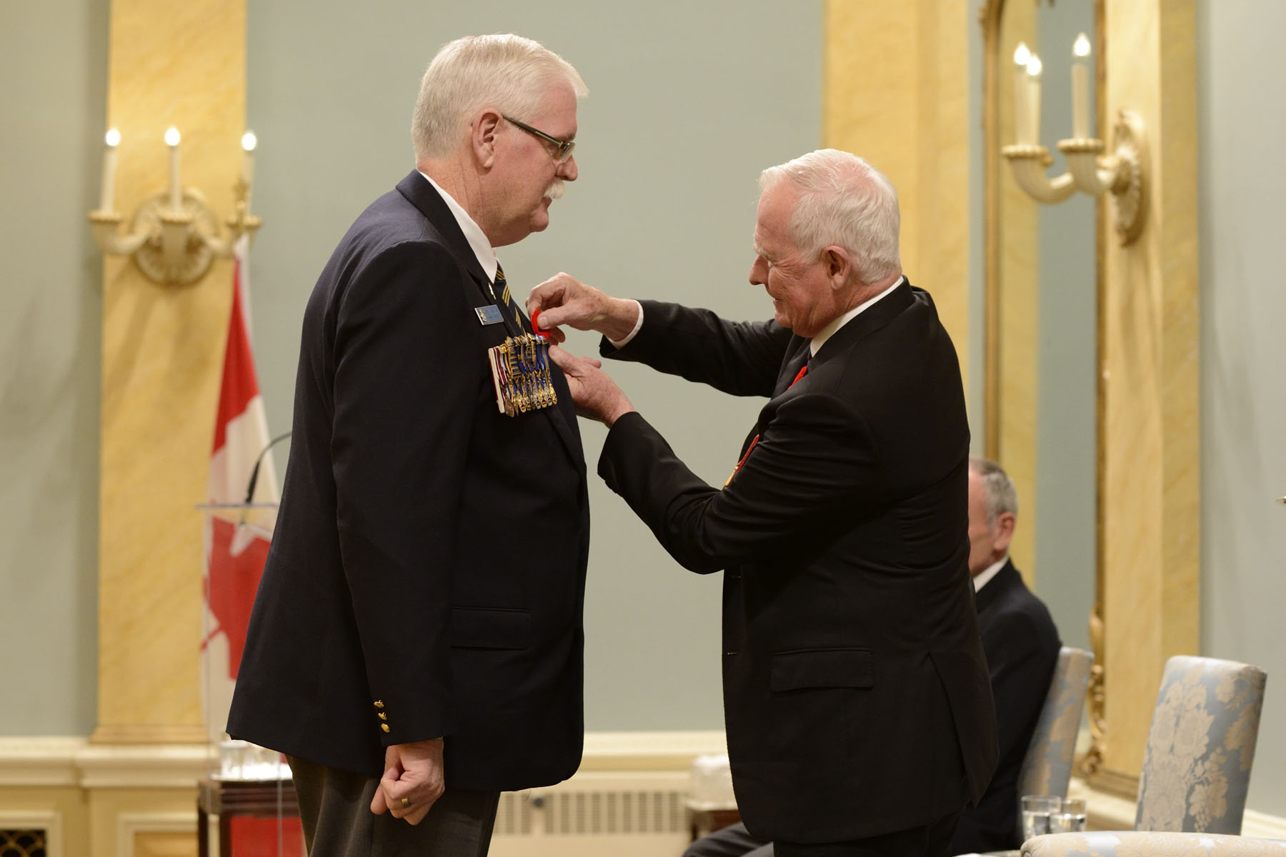 The Governor General presented a poppy on Mr. Eagles.