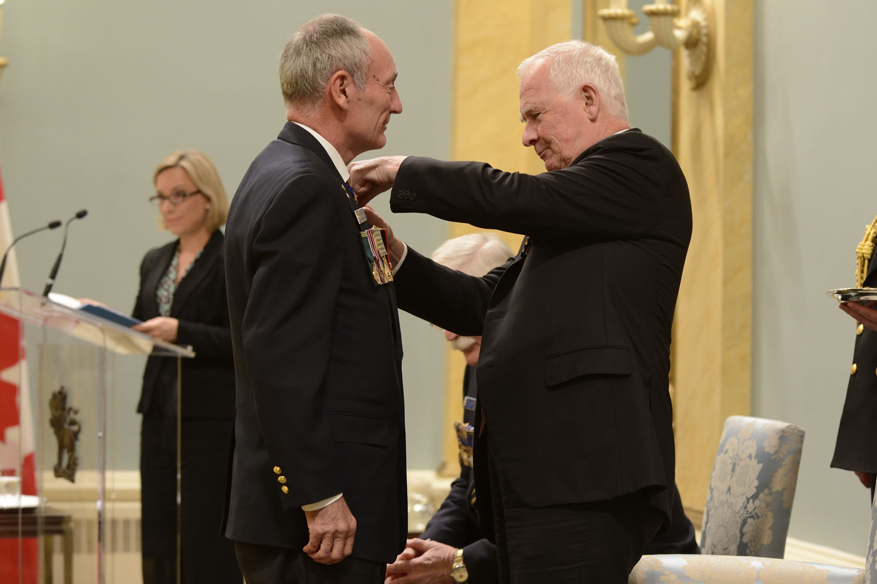 The Governor General presented a poppy to Mr. Murray.