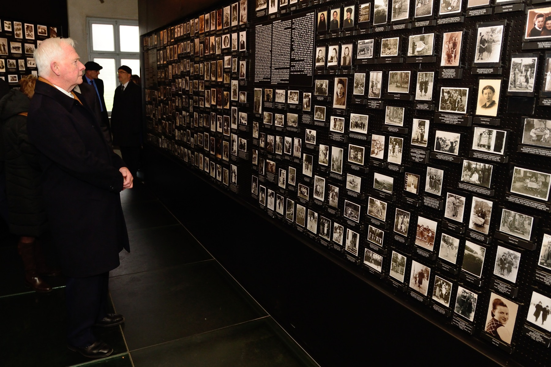 The Governor General took a moment to look at photographs found in the belongings taken from deportees after their arrival at Auschwitz.