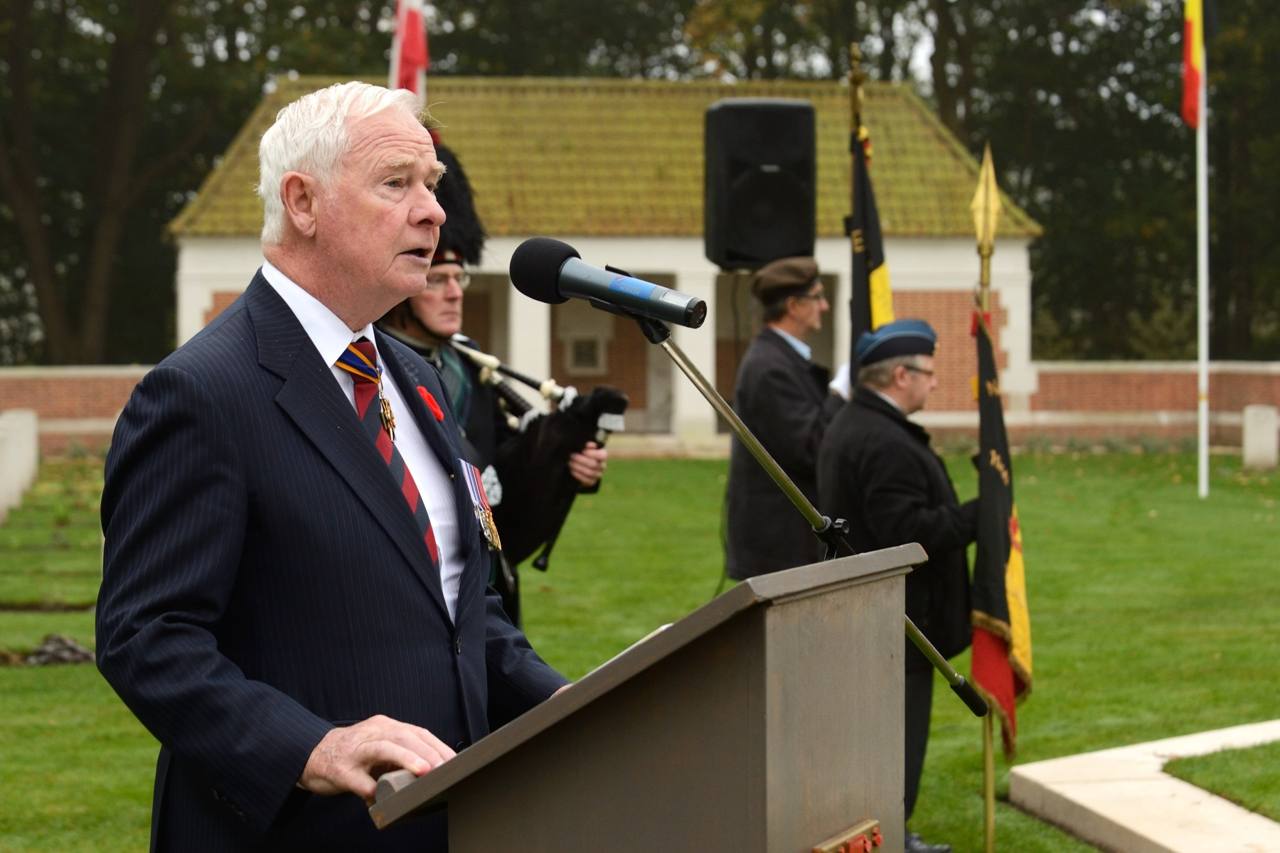 "On October 28, 2014, Their Excellencies the Right Honourable David Johnston, Governor General of Canada, and Mrs. Sharon Johnston, as well as Canadian delegates, paid tribute to those who perished during the Liberation of Belgium in the autumn of 1944 at the Adegem Canadian War Cemetery. ""The bravery and sacrifices of those who fought in this region were central to the outcome of the larger struggle against occupation. I am delighted that one of them, Canadian Second World War Veteran Sidney Cole, is among us. This part of Belgium, its waterways, landscapes and communities will always hold a prominent place in the hearts of Canadians,"" said His Excellency."
