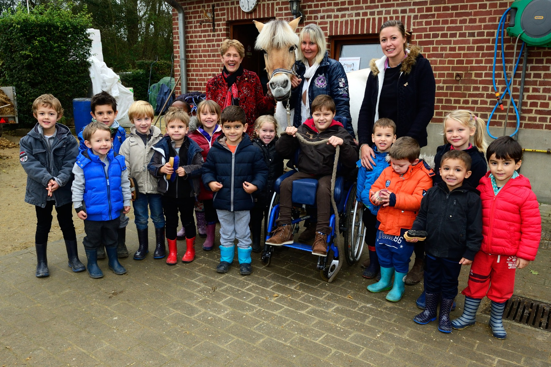 Her Excellency with children and staff from Pony Paradise