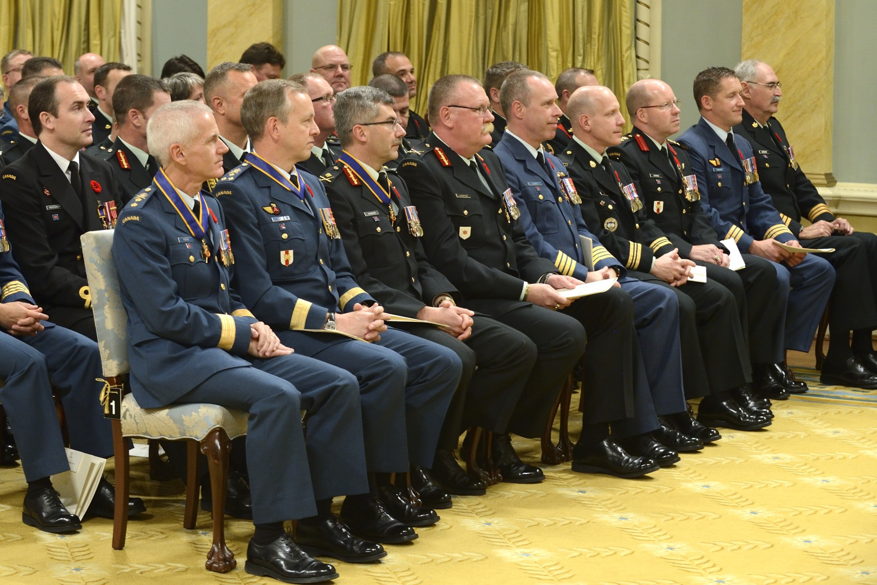 His Excellency the Right Honourable David Johnston, Governor General and Commander-in-Chief of Canada, presided over an Order of Military Merit investiture ceremony at Rideau Hall on November 7, 2014. He bestowed the honour on 50 recipients.