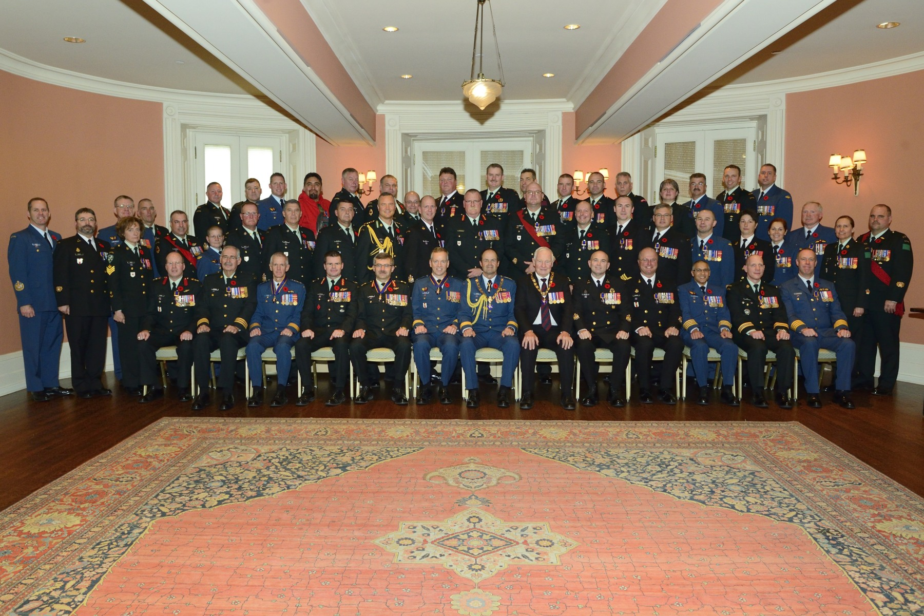 The Governor General and the Chief of the Defence Staff are pictured with the 50 recipients.