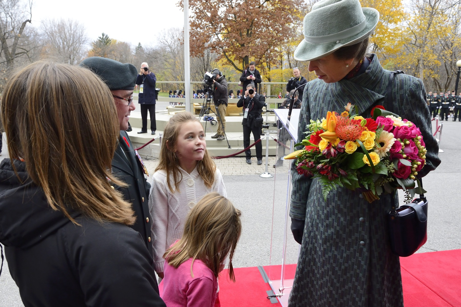 Flowers were given to Her Royal Highness by Memphis Zopf (7 years old) and Mylee Zopf (4 years old). Memphis and Mylee are the daughters of Sgt Chad Zopf, a Canadian Armed Forces Communication signaller from Regina, Saskatchewan. The family currently lives in the Ottawa Region.