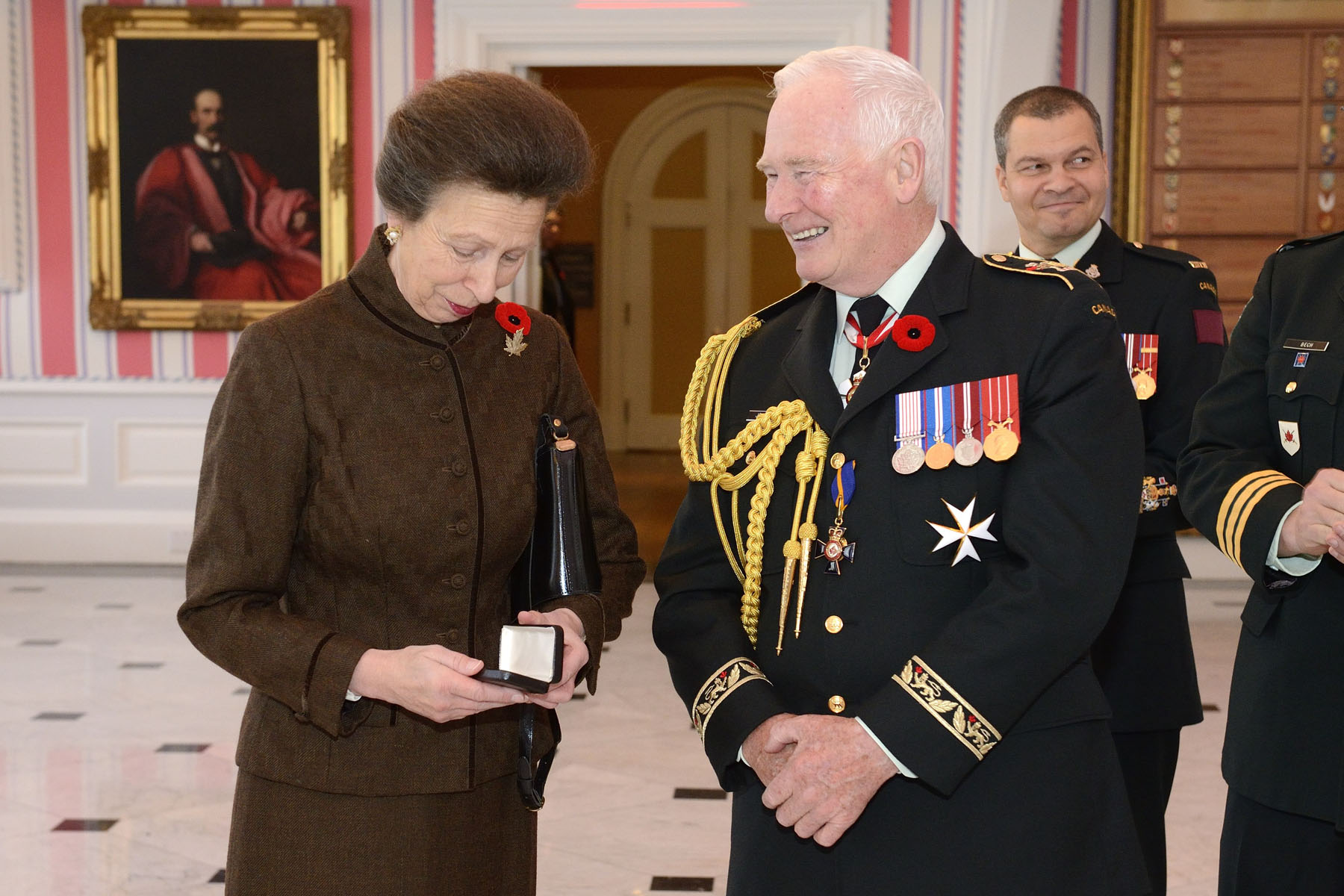 Prior to Remembrance Day Ceremony, His Excellency presented Her Royal Highness with the third clasp of the Canadian Forces' Decoration. The Canadian Forces' Decoration is awarded to officers and non-commissioned members of the Canadian Armed Forces who have completed 12 years of service. A clasp is awarded for every subsequent period of 10 years of qualifying service.