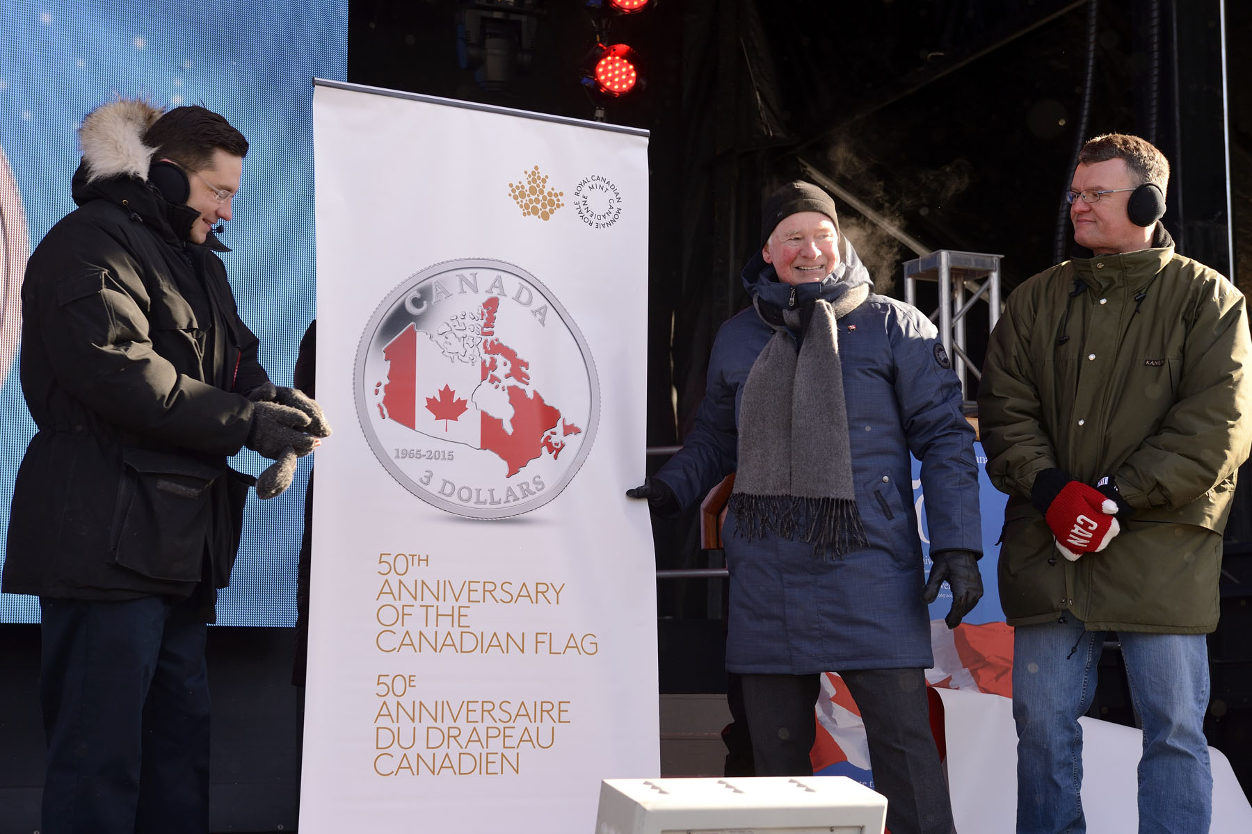 The Governor General also unveiled a new coin with Mr. Michel Boucher, Vice President of the Royal Canadian Mint (right) and Minister Poilievre (left).