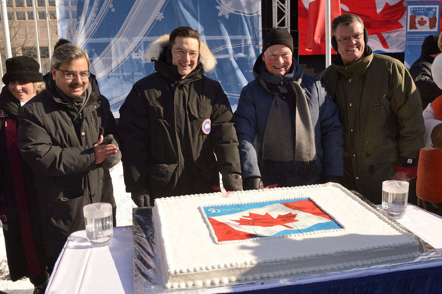 His Excellency and dignitaries cut the cake to celebrate the Canadian flag's anniversary.