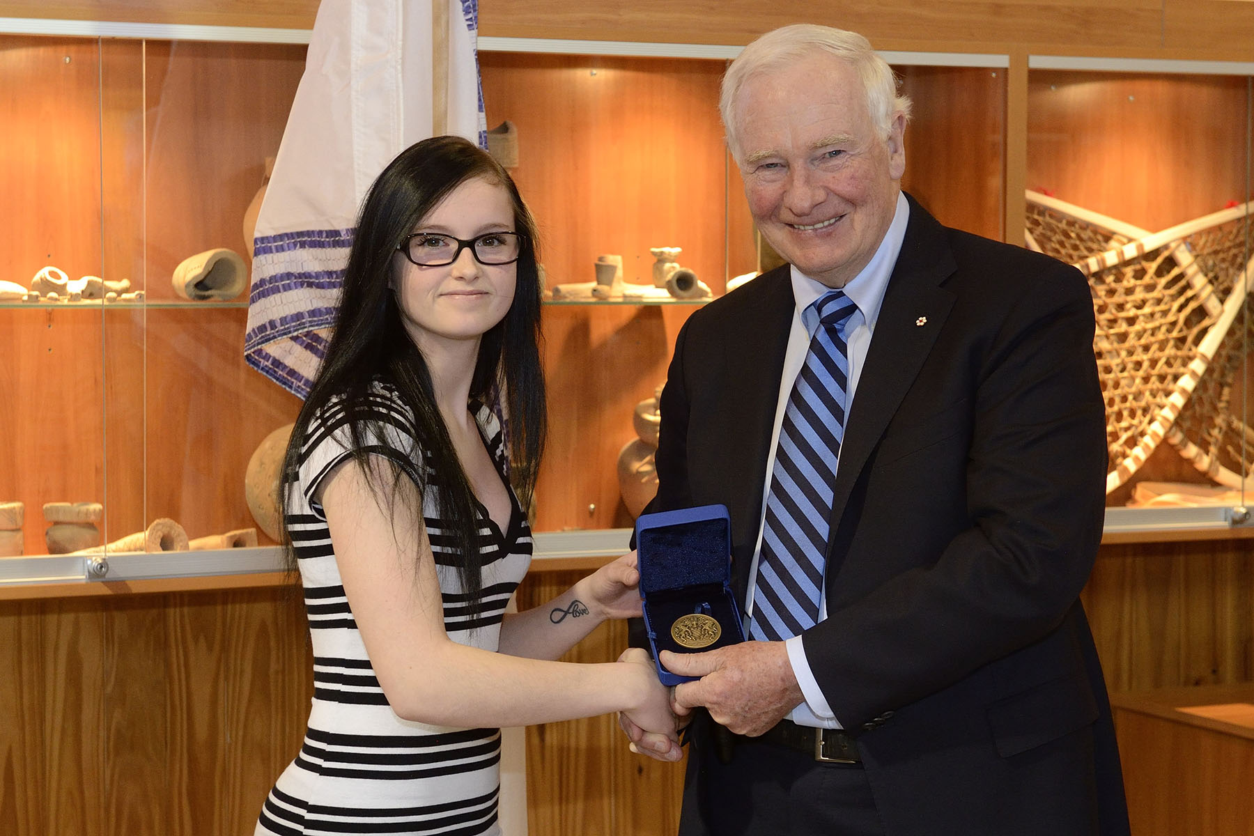 His Excellency presented a Bronze-level Governor General's Academic Medal to Shania Gasse who graduated with the highest average from a secondary-level institution in 2014.