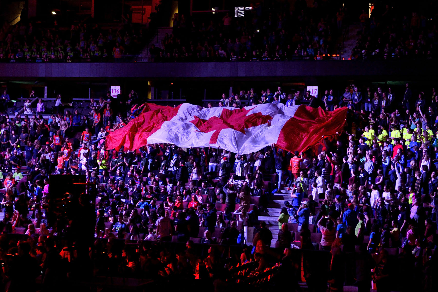 Before the Governor General's appearance on stage, a giant Canadian flag was past along by the crowd around the arena.