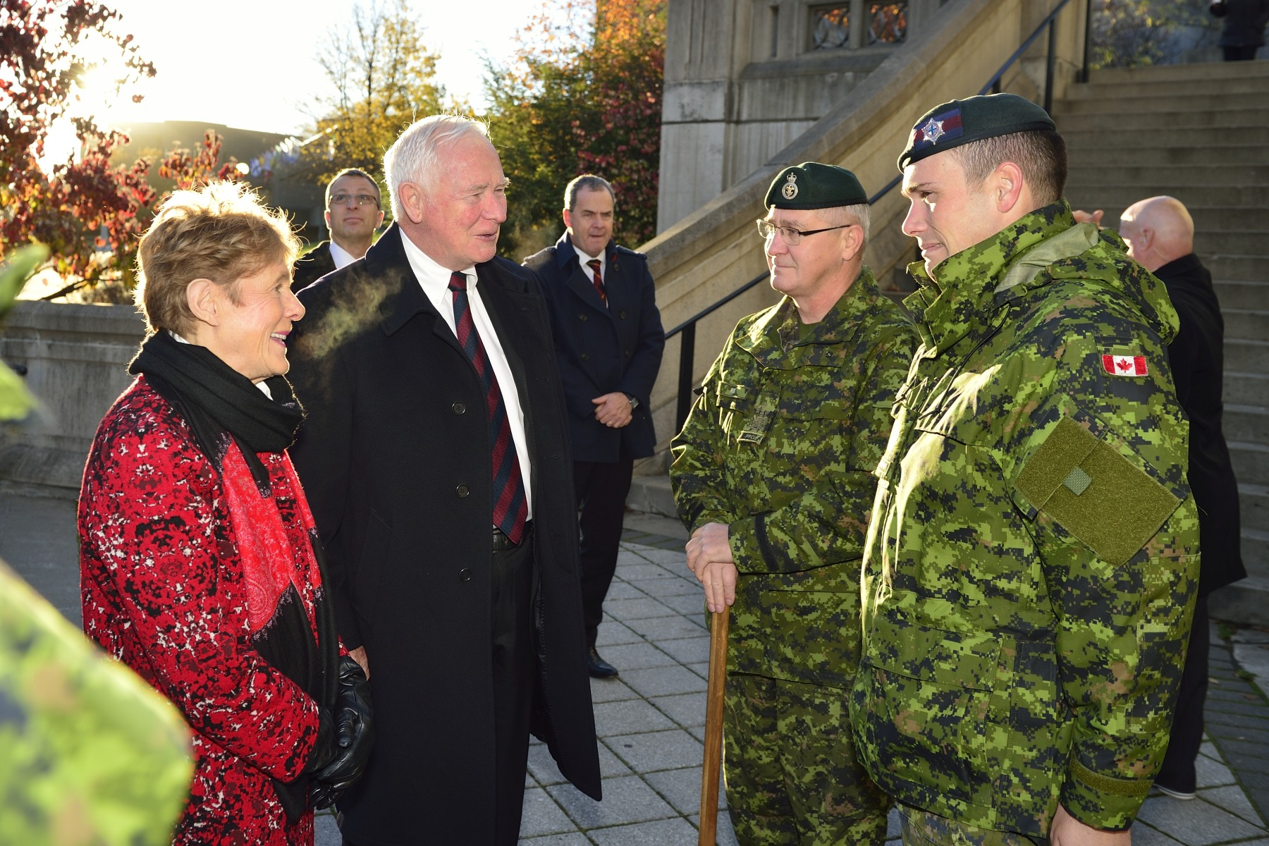 Upon their arrival at Plaza Barracks, Their Excellencies the Right Honourable David Johnston, Governor General and Commander-in-Chief of Canada, met with Padre Andrew Love (left) and	Colour Sergeant Tim Perry, Office of Primary Interest for National Sentry Program (right).