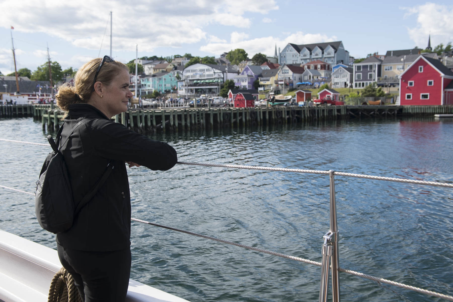 Her Excellency admiring the beautiful landscape as the Bluenose II sailed around the bay.