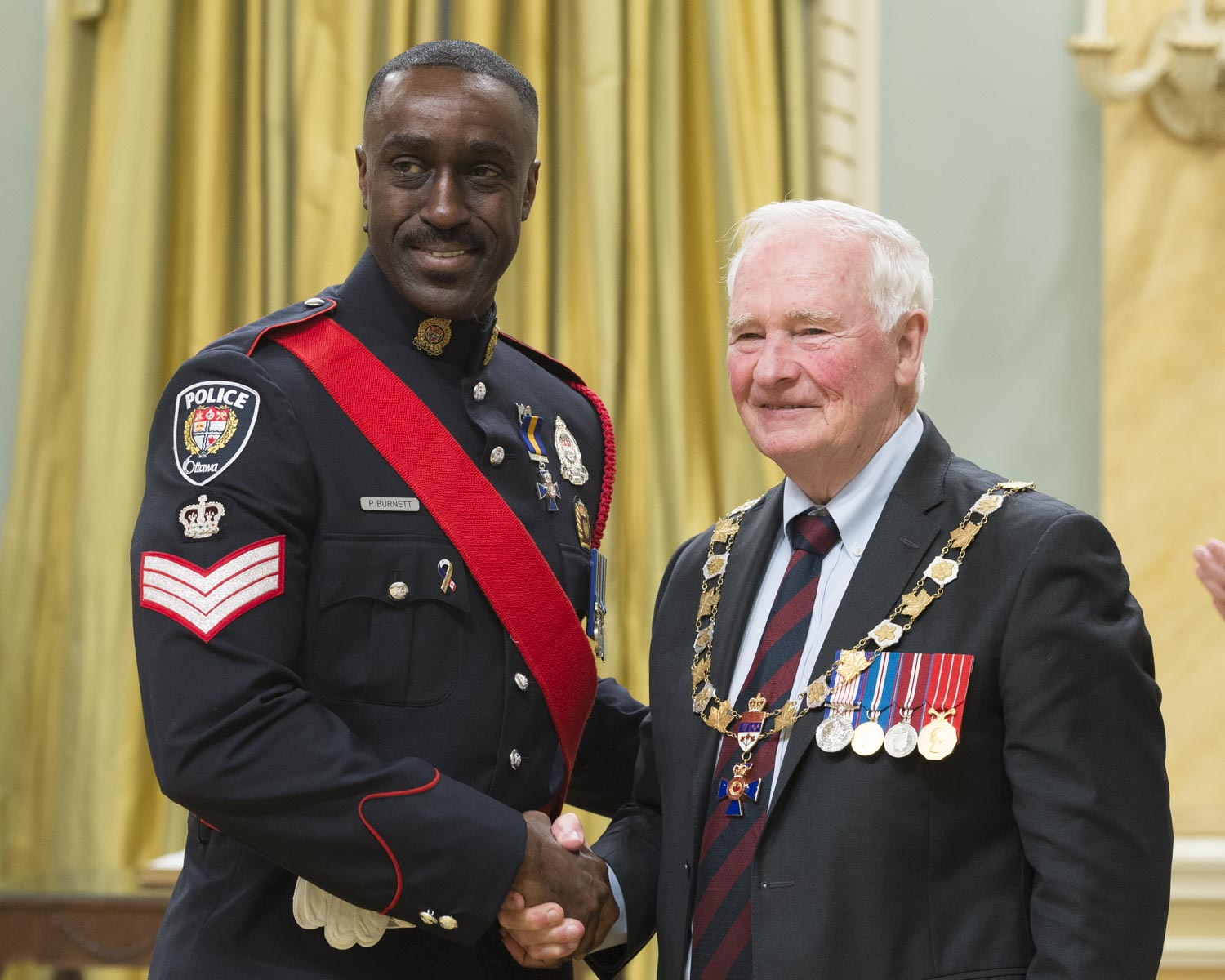 His Excellency presented the Order at the Member level to Staff Sergeant Paul Alexander Burnett, M.O.M., of the Ottawa Police Service, Ontario.