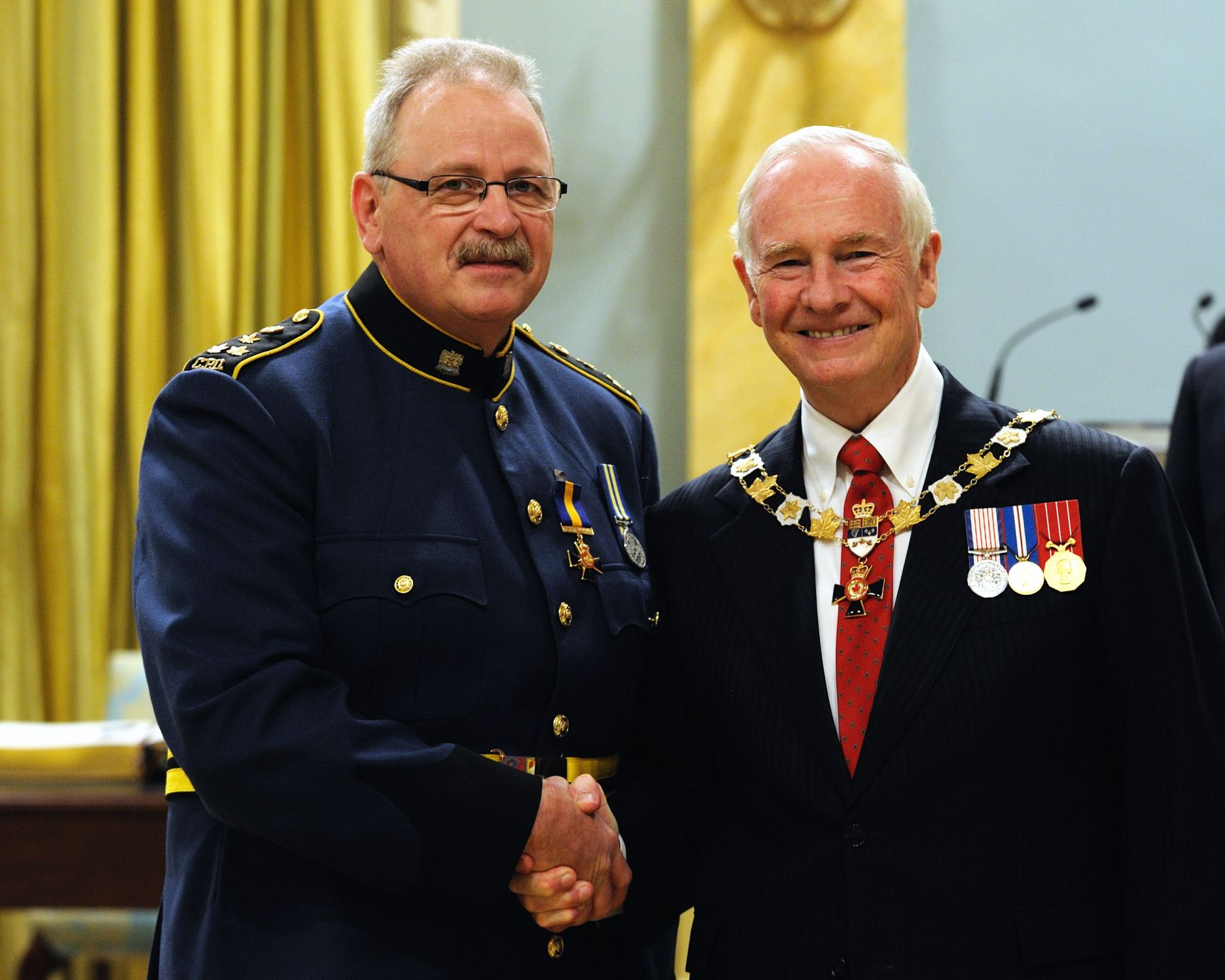 His Excellency presented the Order of Merit of the Police Forces at the Officer level (O.O.M.) to Chief A. Paul Smith, O.O.M., of the Charlottetown Police Services, Prince Edward Island.
