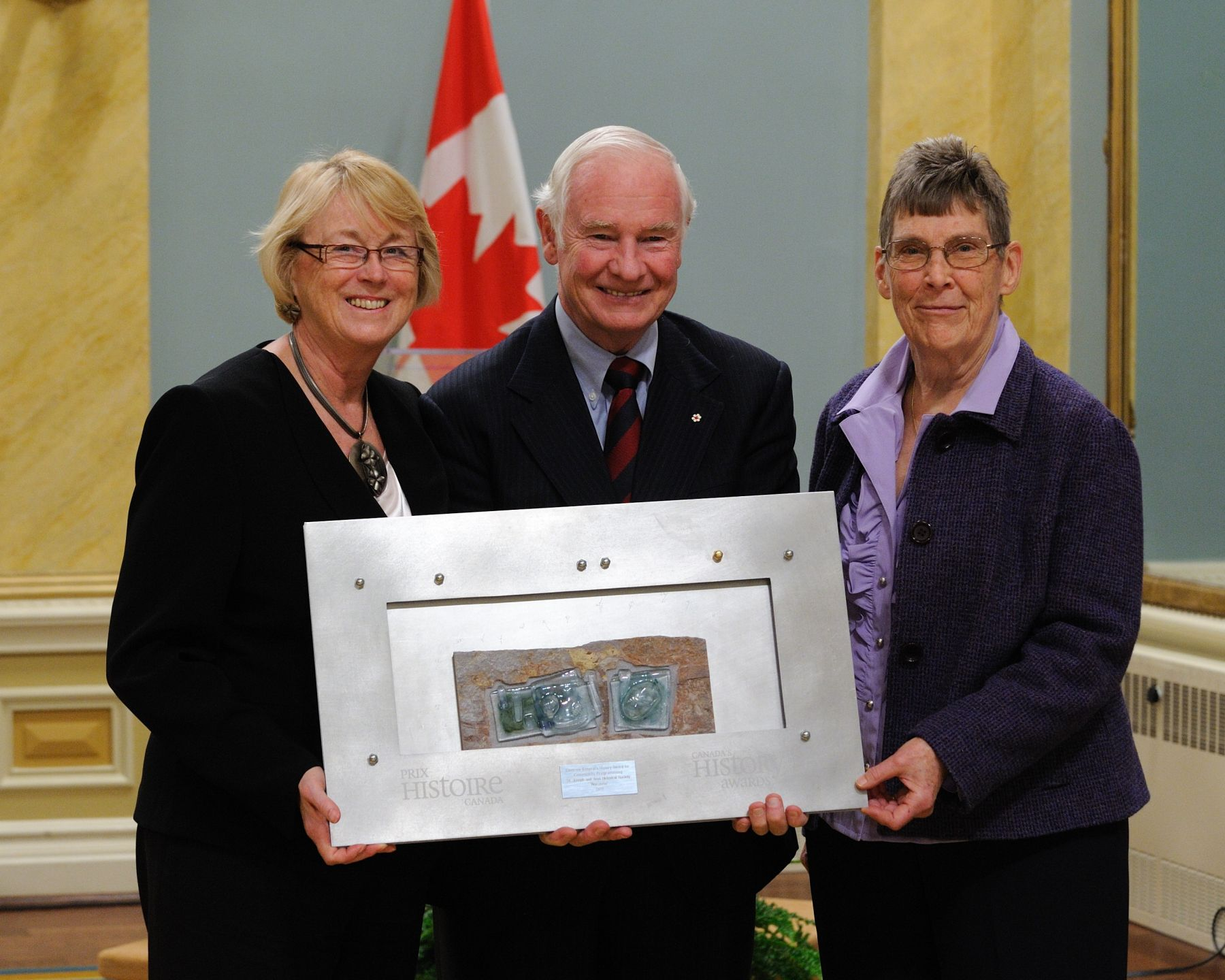 His Excellency awarded the Governor General's History Awards for Excellence in Community Programming to Joan Karstens and Pat Rowe of the St. Joseph and Area Historical Society for Narcisse, a play recounting the story of one of Huron County's most colourful residents, Narcisse Cantin.