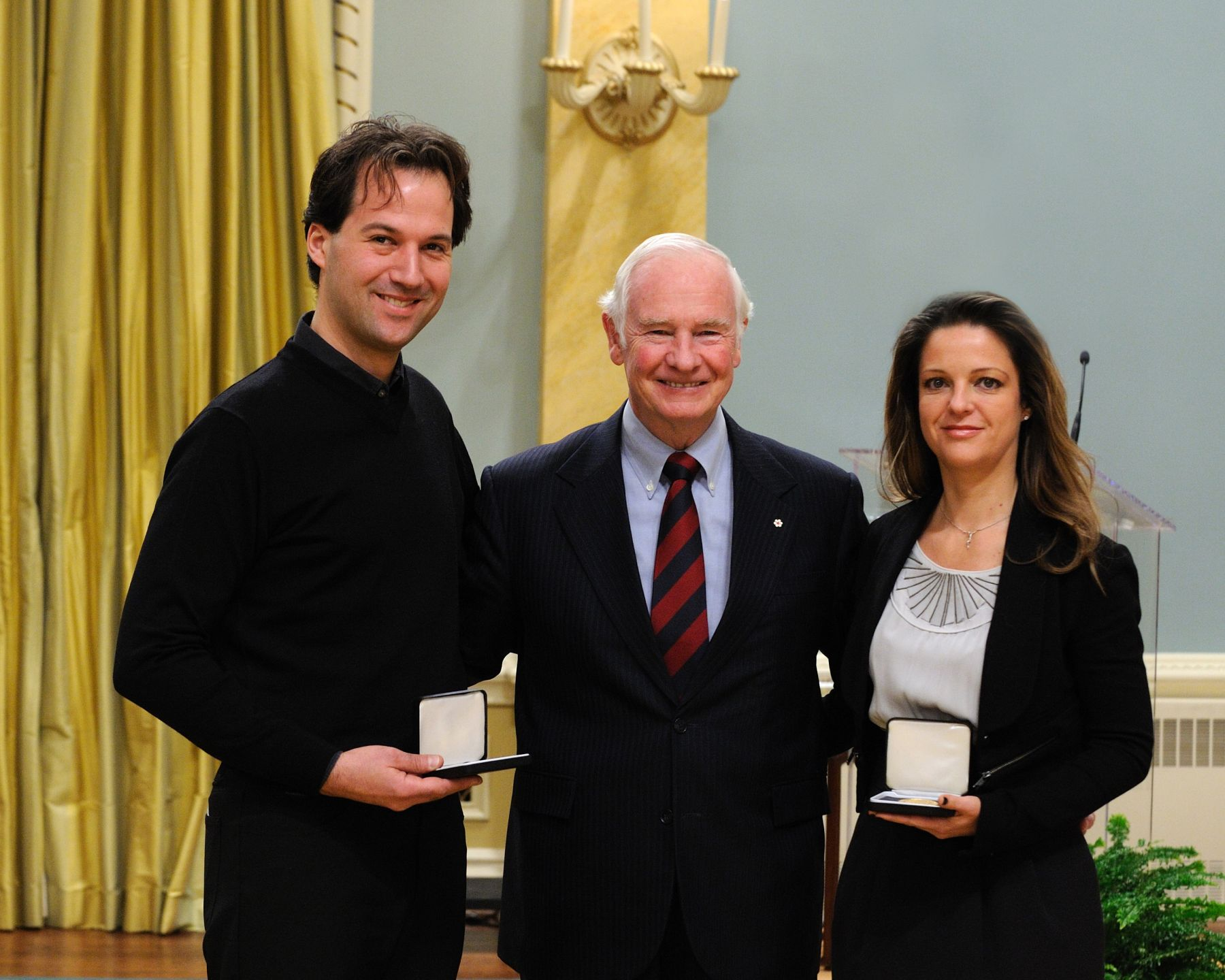 "His Excellency awarded the Governor General's History Award for Popular History - Pierre Berton Award 2011 - to Guylaine Maroist and Eric Ruel for the film ""J'ai la mémoire qui tourne""."