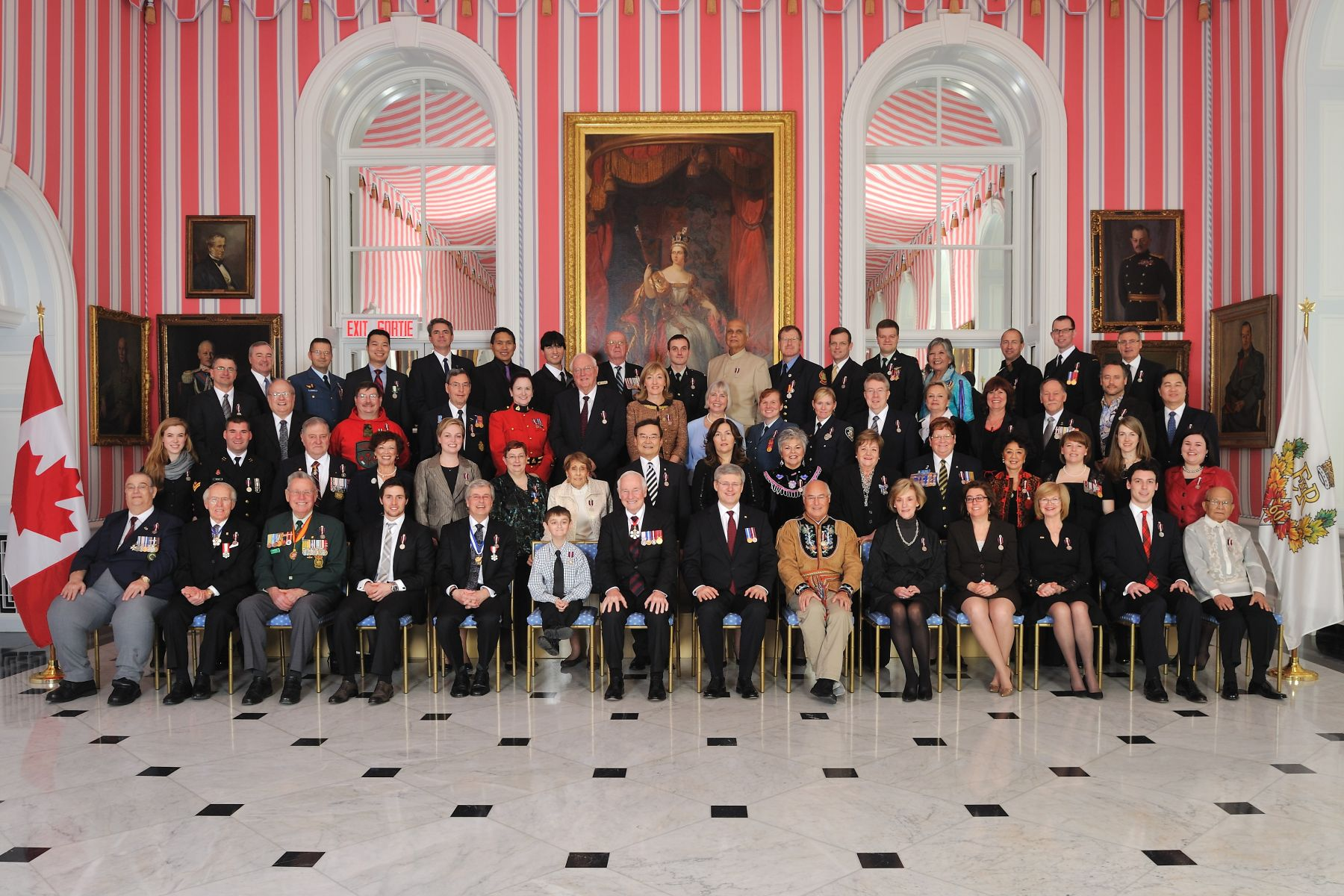 His Excellency the Right Honourable David Johnston, Governor General of Canada, and the Right Honourable Stephen Harper, Prime Minister of Canada, are pictured with the 60 recipients who were presented with the Diamond Jubilee Medal.