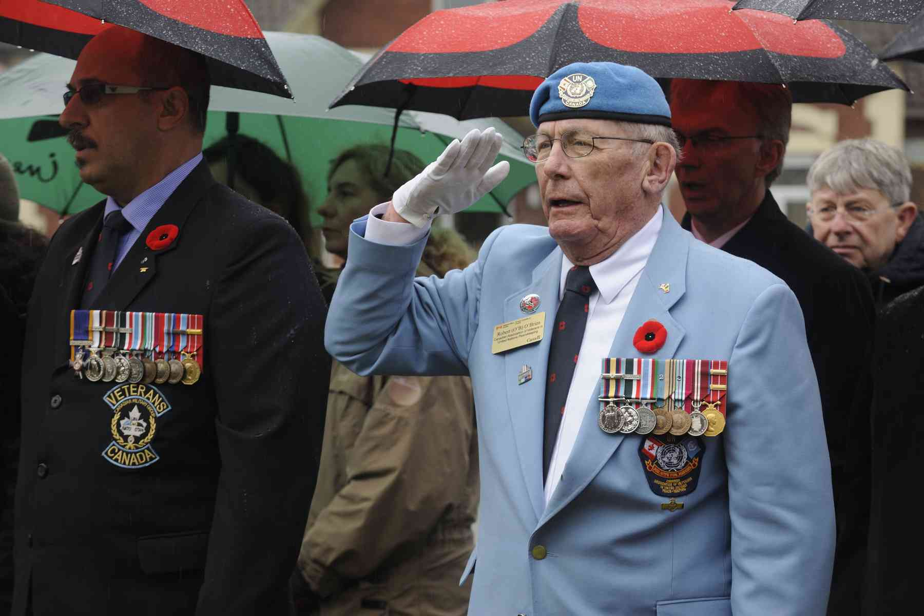 Mr. Robert O'Brien of the Canadian Association of Veterans in United Nations Peacekeeping salutes proudly.