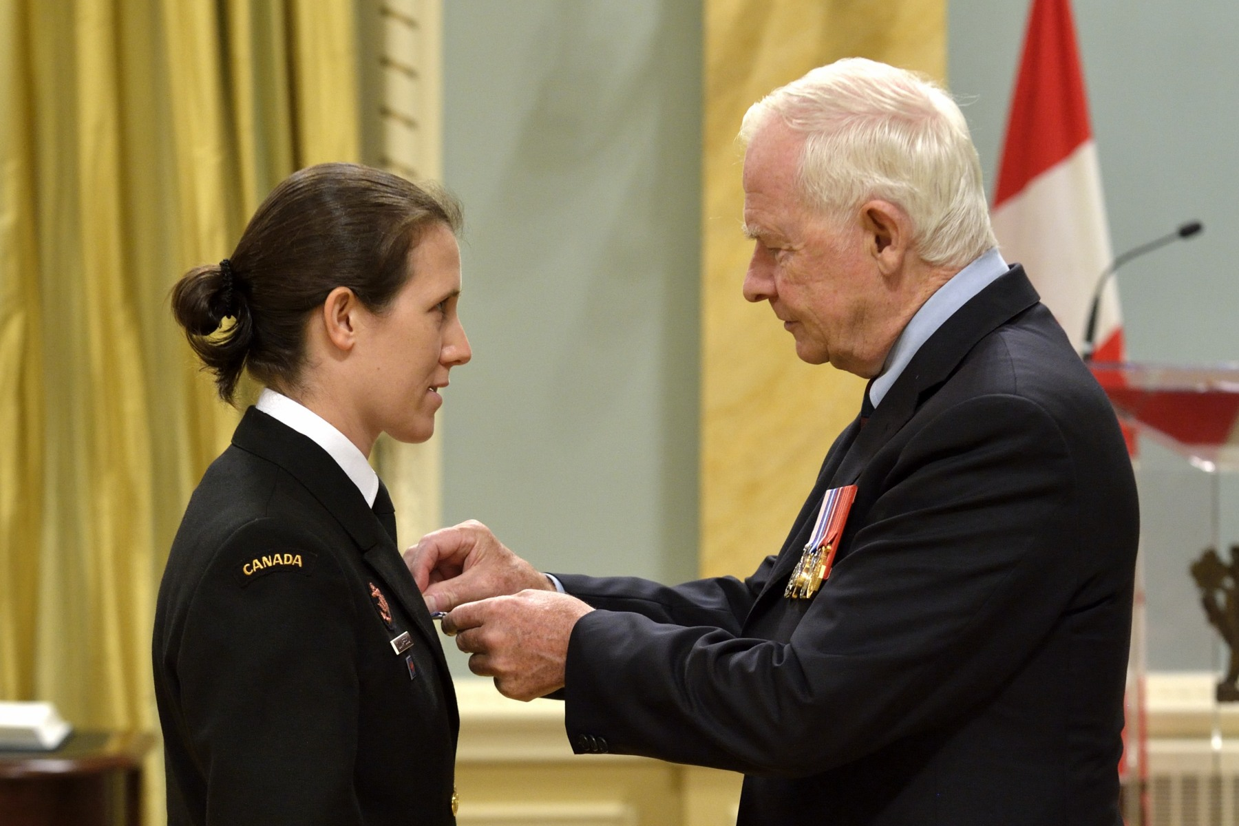 Sub-Lieutenant Michèle Claudette Dumaresq-Ouellet, M.S.M., C.D. (Montréal, Quebec) received the Meritorious Service Medal (Military Division). Sub-Lieutenant Dumaresq-Ouellet contributed to the success of operations of HMCS Toronto from 2008 to 2010. She served as senior electronic sensor operator, a position that went beyond the requirements of her rank and qualifications, and demonstrated remarkable innovation in developing new ship-to-shore warfare tactics. Sub-Lieutenant Dumaresq-Ouellet's leadership and professionalism were essential to the ship's operational success and brought honour to the Canadian Armed Forces.