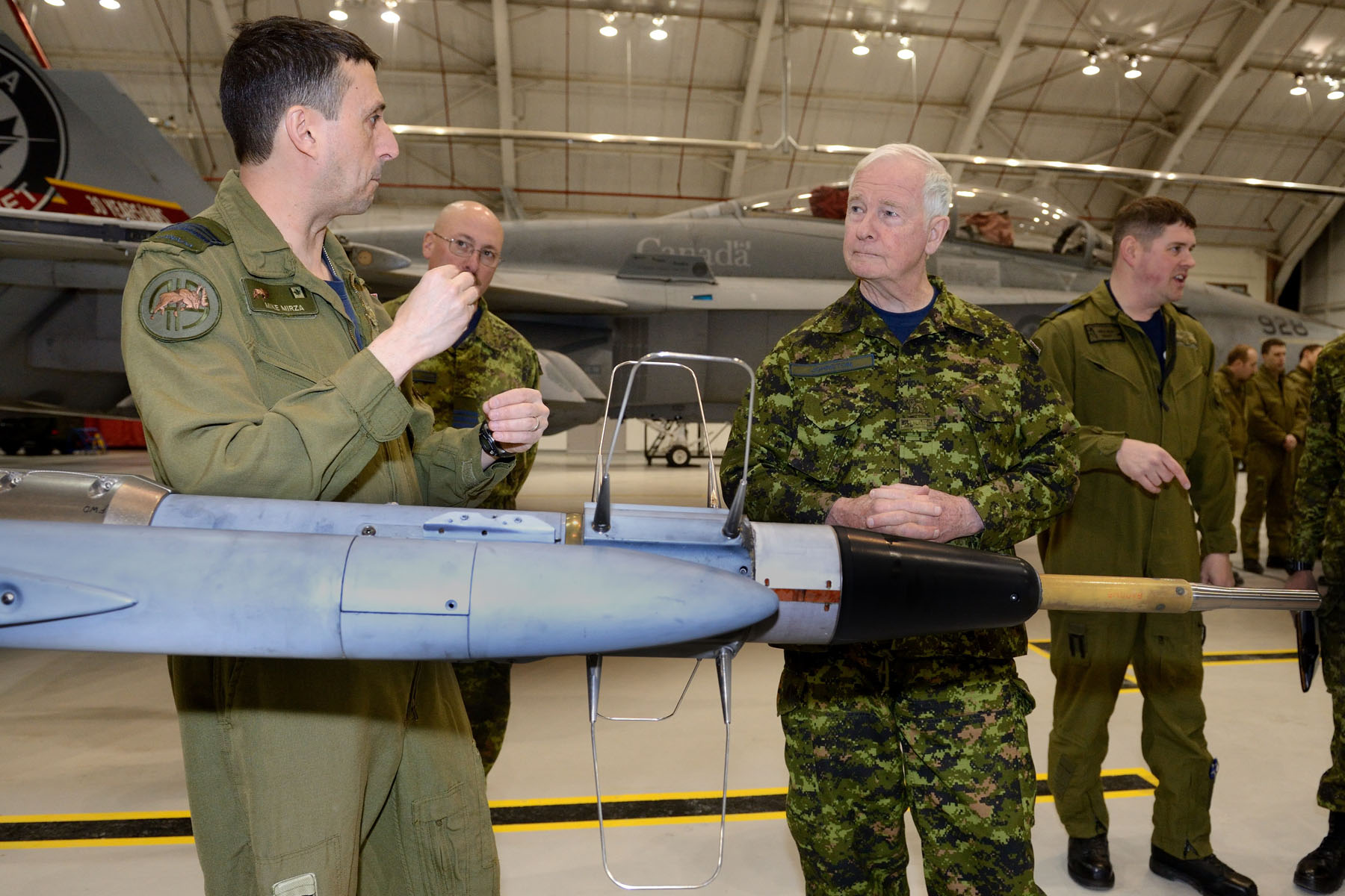 The Governor General then toured the 409 Tactical Fighter Squadron's hangar and viewed various static displays. He first met with Canadian Armed Forces members of the 419 Training Squadron and viewed the CT-155 Hawk static display. He then proceeded to the 410 Training Squadron display and met with students and viewed the CF-188 Hornet.