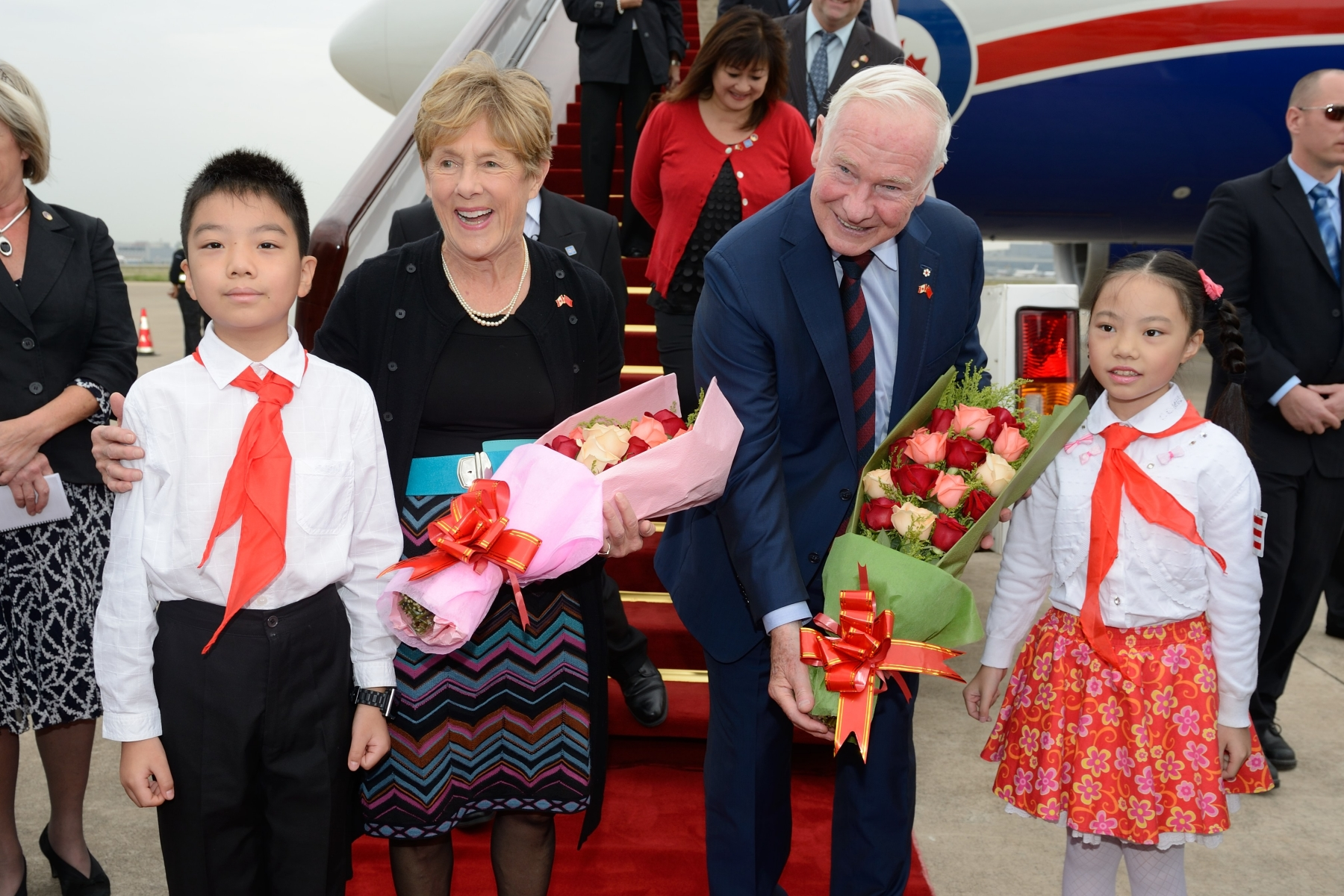 Upon their arrival in Shanghai, Their Excellencies were offered flowers by children.