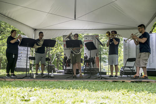 Musicians play their instruments under a tent on the grounds of Rideau Hall during Chamberfest.