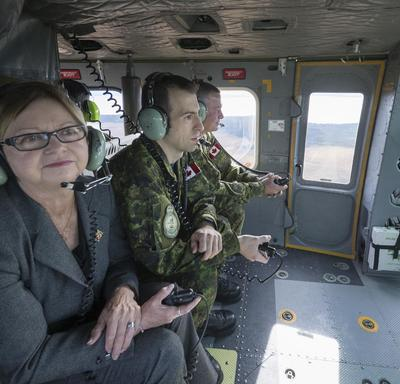Her Honour the Honourable Judy Foote, Lieutenant Governor of Newfoundland and Labrador, alongside the commander of the base, Lieutenant-Colonel Stéphane Racle, also participated in the familiarization flight.