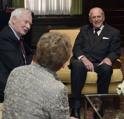 The Duke of Edinburgh is engaged in conversation with Governor General Johnston and Mrs. Sharon Johnston.