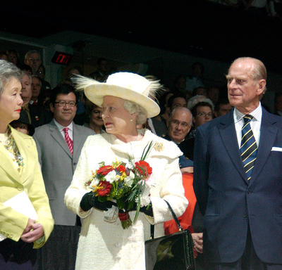 John Ralston Saul, Governor General Clarkson, The Queen and the Duke of Edinburgh stand facing each other, as guests look on from the background.